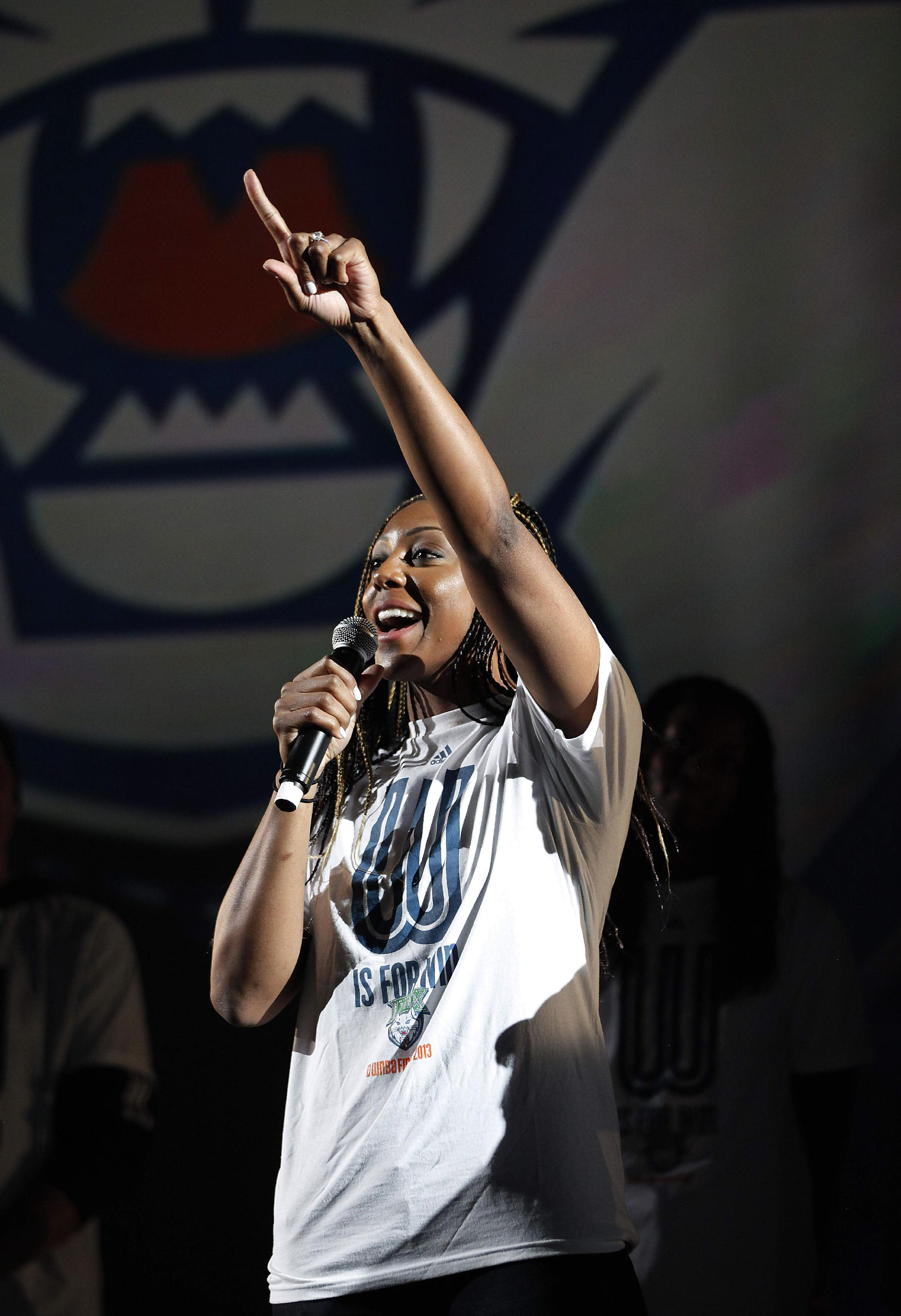Minnesota Lynx guard Monica Wright rallies up the crowd during the celebration for the team's recent WNBA Championship title, Monday, Oct. 14, 2013, in Minneapolis