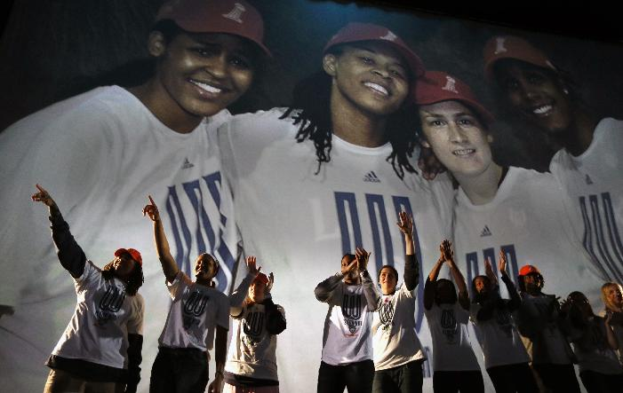 WNBA basketball champion Minnesota Lynx players respond to fans during a victory celebration at Target Center in Minneapolis, Monday, Oct. 14, 2013