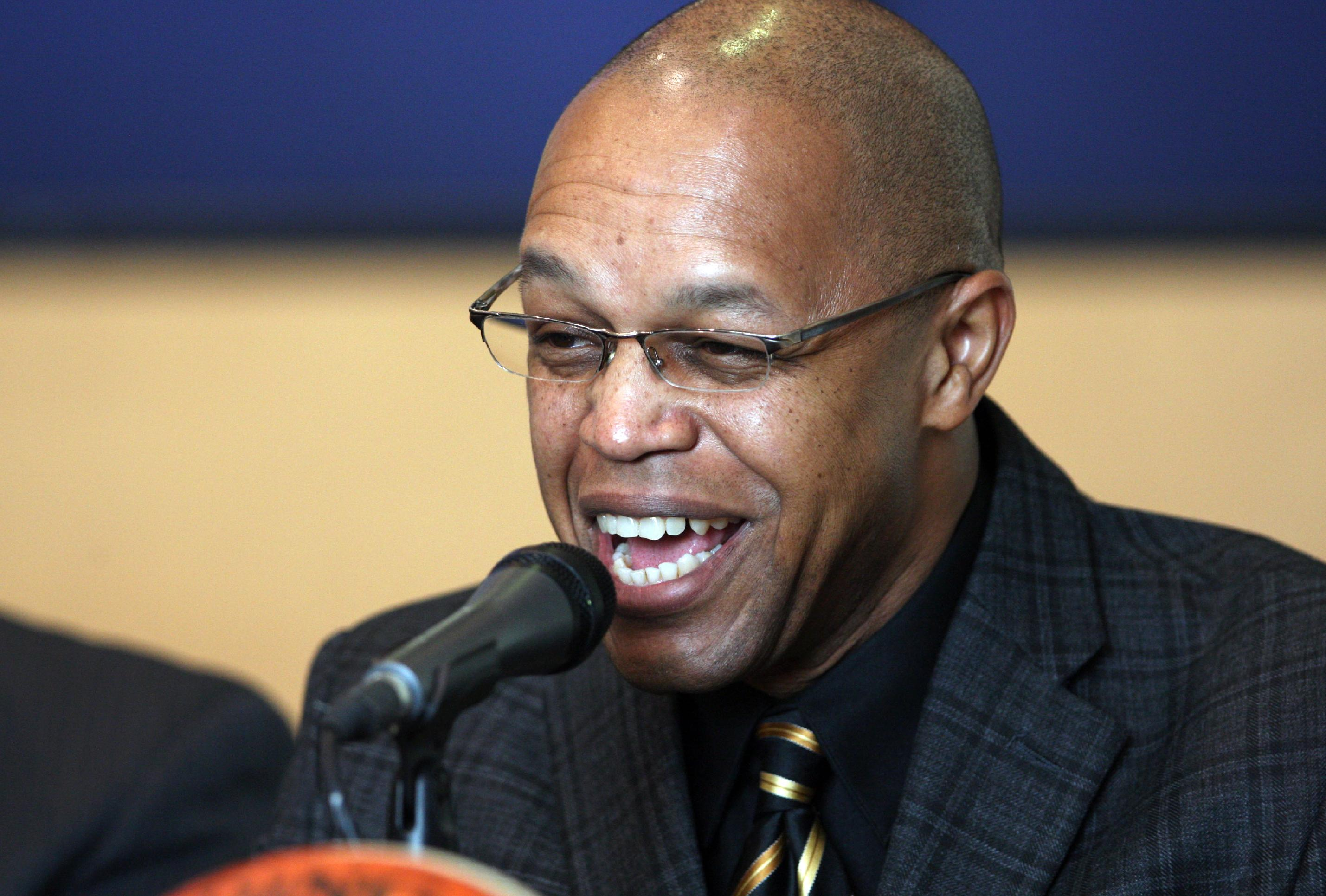 Fred Williams smiles as he is announced as coach of the Tulsa Shock WNBA basketball team, during a news conference in Tulsa, Okla., on Thursday, Jan. 23, 2014