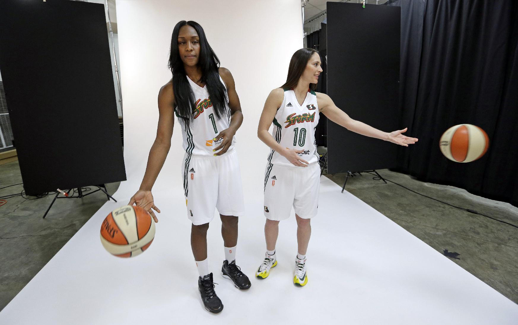 Seattle Storm's Crystal Langhorne, left, and Sue Bird toss aside basketballs during a photo session at the team's annual media day Wednesday, May 7, 2014, in Seattle. The team opens against the Los Angeles Sparks on May 16 in Seattle