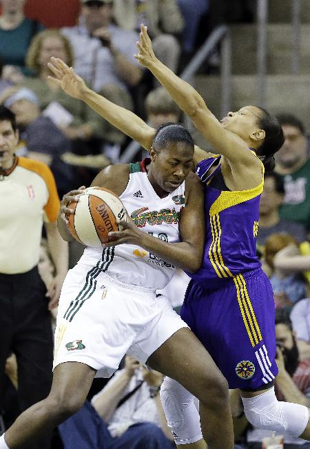 Los Angeles Sparks' Armintie Herrington, right, and Seattle Storm's Shekinna Stricklen collide in the first half of a WNBA basketball game Friday, May 16, 2014, in Seattle