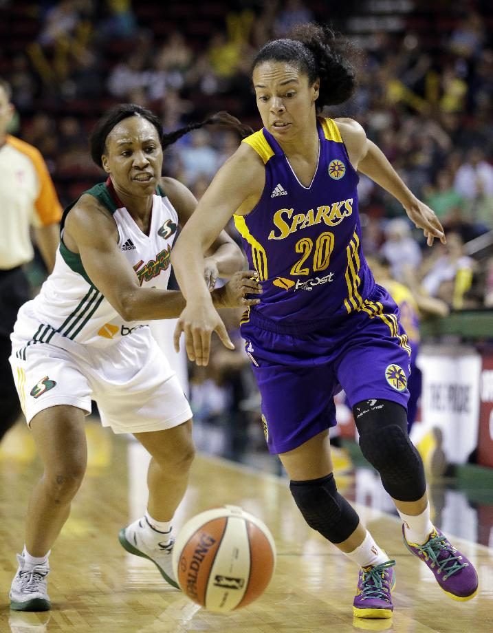 Los Angeles Sparks' Kristi Toliver (20) races past Seattle Storm's Temeka Johnson in the second half of a WNBA basketball game Friday, May 16, 2014, in Seattle. The Sparks won 80-69