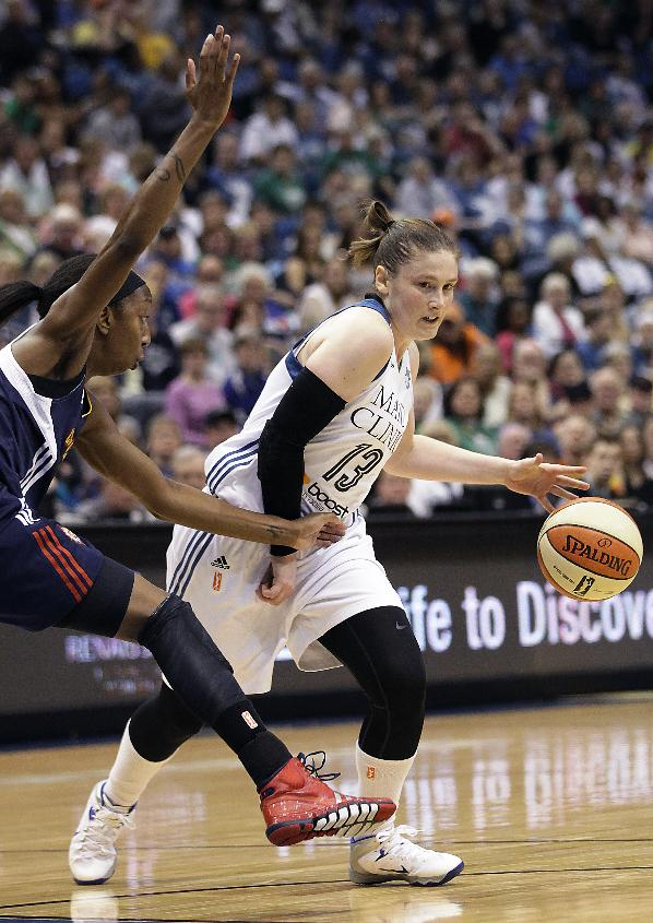 CORRECTS MONTH - Minnesota Lynx guard Lindsay Whalen (13) passes the ball while being fouled by Connecticut Sun guard Allison Hightower (3) in the first half of a WNBA basketball game, Sunday, May 18, 2014, in Minneapolis