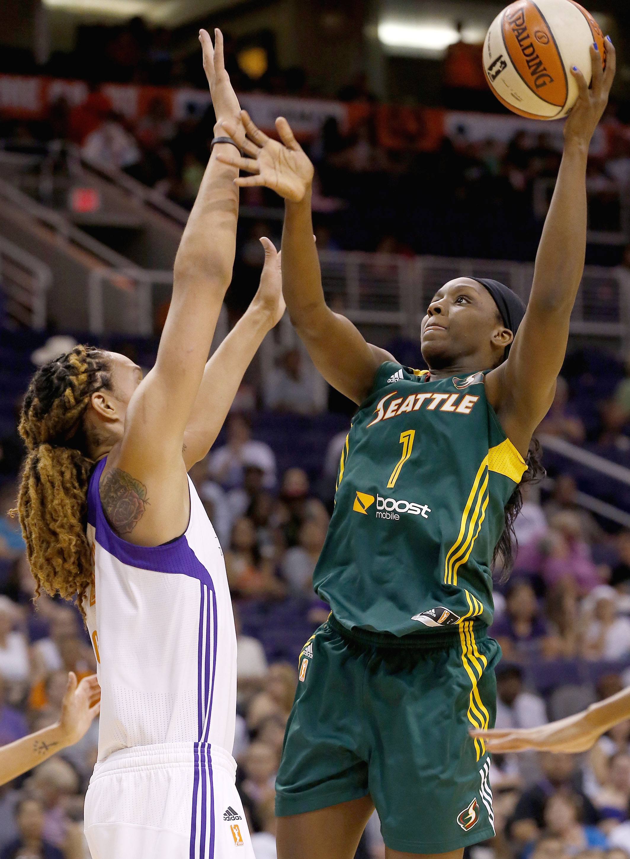 Seattle Storm's Crystal Langhorne (1) shoots over Phoenix Mercury's Brittney Griner, left, during the first half of a WNBA basketball game on Tuesday, June 3, 2014, in Phoenix