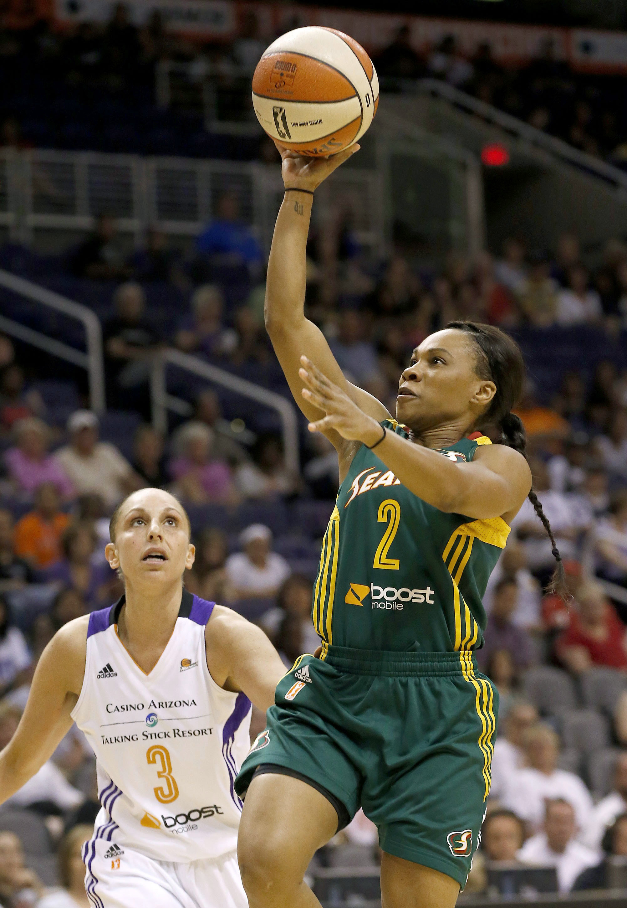 Seattle Storm's Temeka Johnson (2) shoots as she gets past Phoenix Mercury's Diana Taurasi (3) during the first half of a WNBA basketball game on Tuesday, June 3, 2014, in Phoenix
