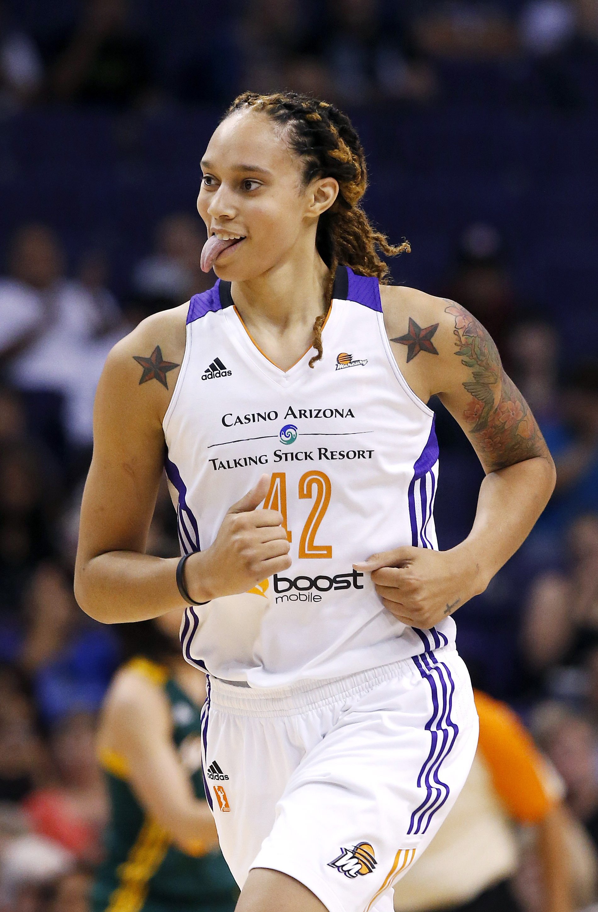 Phoenix Mercury's Brittney Griner sticks her tongue out after scoring a basket against the Seattle Storm during the first half of a WNBA basketball game on Tuesday, June 3, 2014, in Phoenix