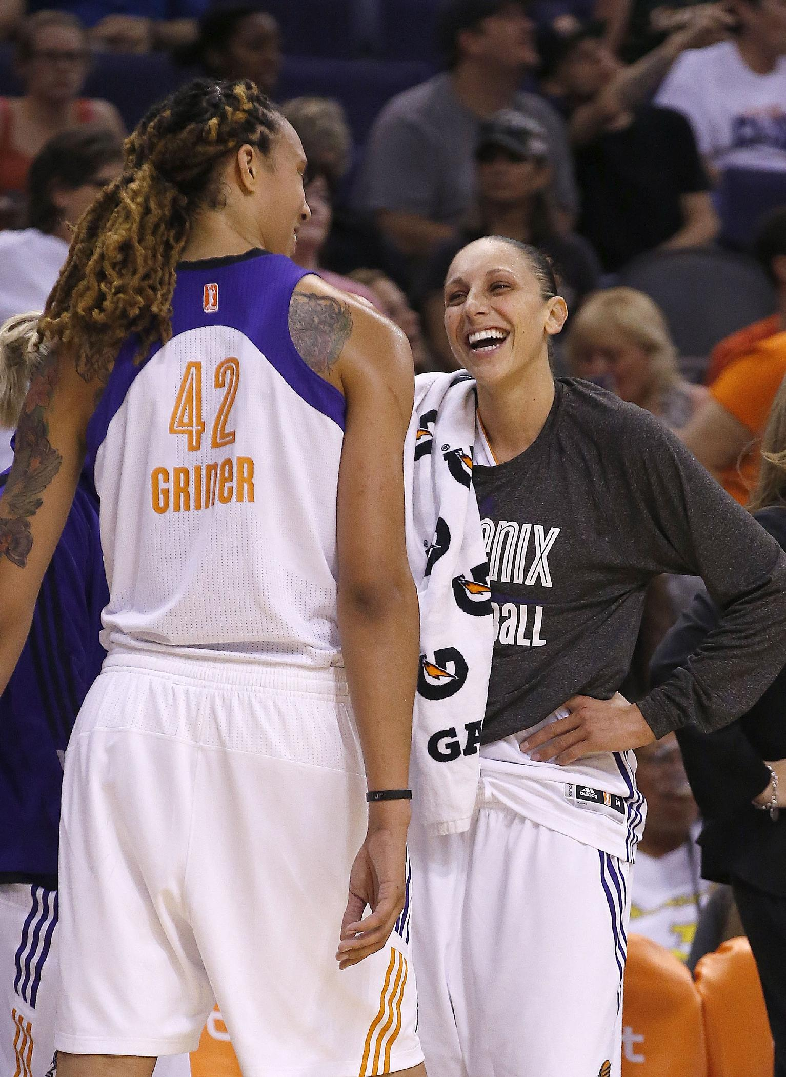 Phoenix Mercury's Diana Taurasi, right, and Brittney Griner (42) talk on the team bench in the closing moments of their win against the Seattle Storm during the second half of a WNBA basketball game on Tuesday, June 3, 2014, in Phoenix