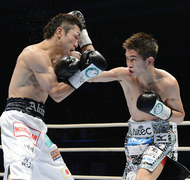 WBA Champion Kazuto Ioka Of Japan (R) Lands AFP/Getty Images