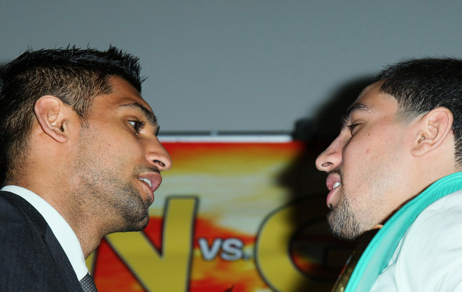 Amir Khan (left) and Danny Garcia will face off in the ring on Saturday night in Las Vegas. (Getty Images)