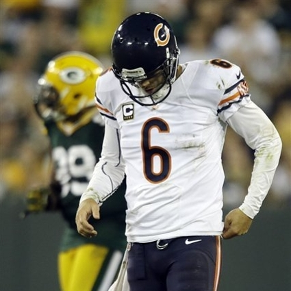 Chicago's Jay Cutler walks off the field after being sacked during the second half against Green Bay. (AP)