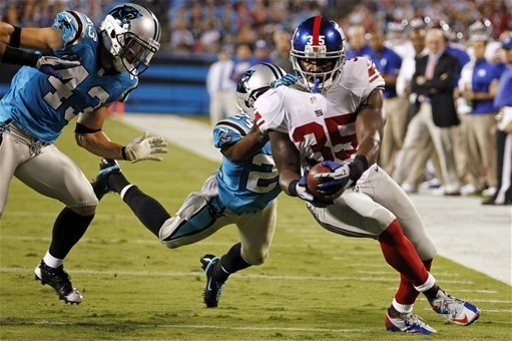 Brown runs for 2 TDs as Giants rout Panthers 36-7 The Associated Press
