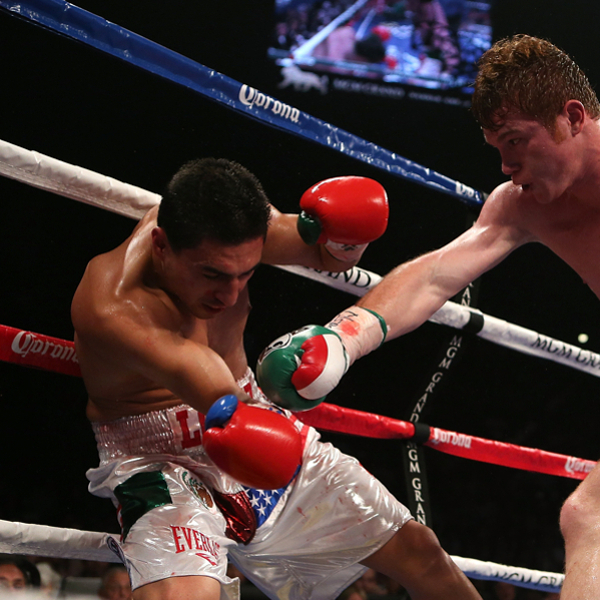 Canelo Alvarez knocks down Josesito Lopez with a right to the head. (Josh Hedges/Getty Images)