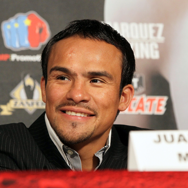 Juan Manuel Marquez has had to grin and bear while taking a backseat to the Floyd and Manny show. (AP)