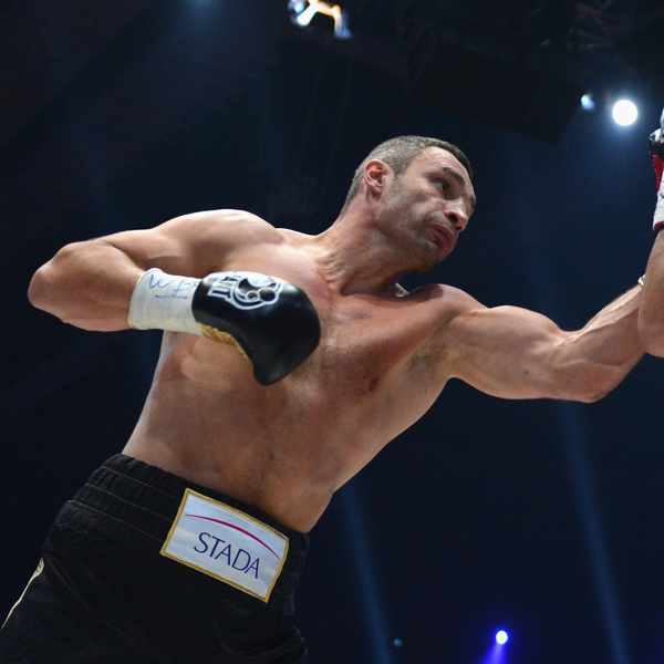 Vitali Klitschko punches Manuel Charr during a heavyweight bout. (Getty)