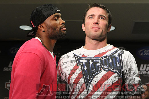 Chael Sonnen and rival Anderson Silva pose at a press conference. (MMAWeekly)