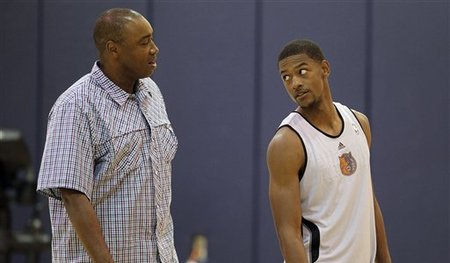 Bobcats president Rod Higgins, left, waived his son Cory because the team needed more size. (AP)