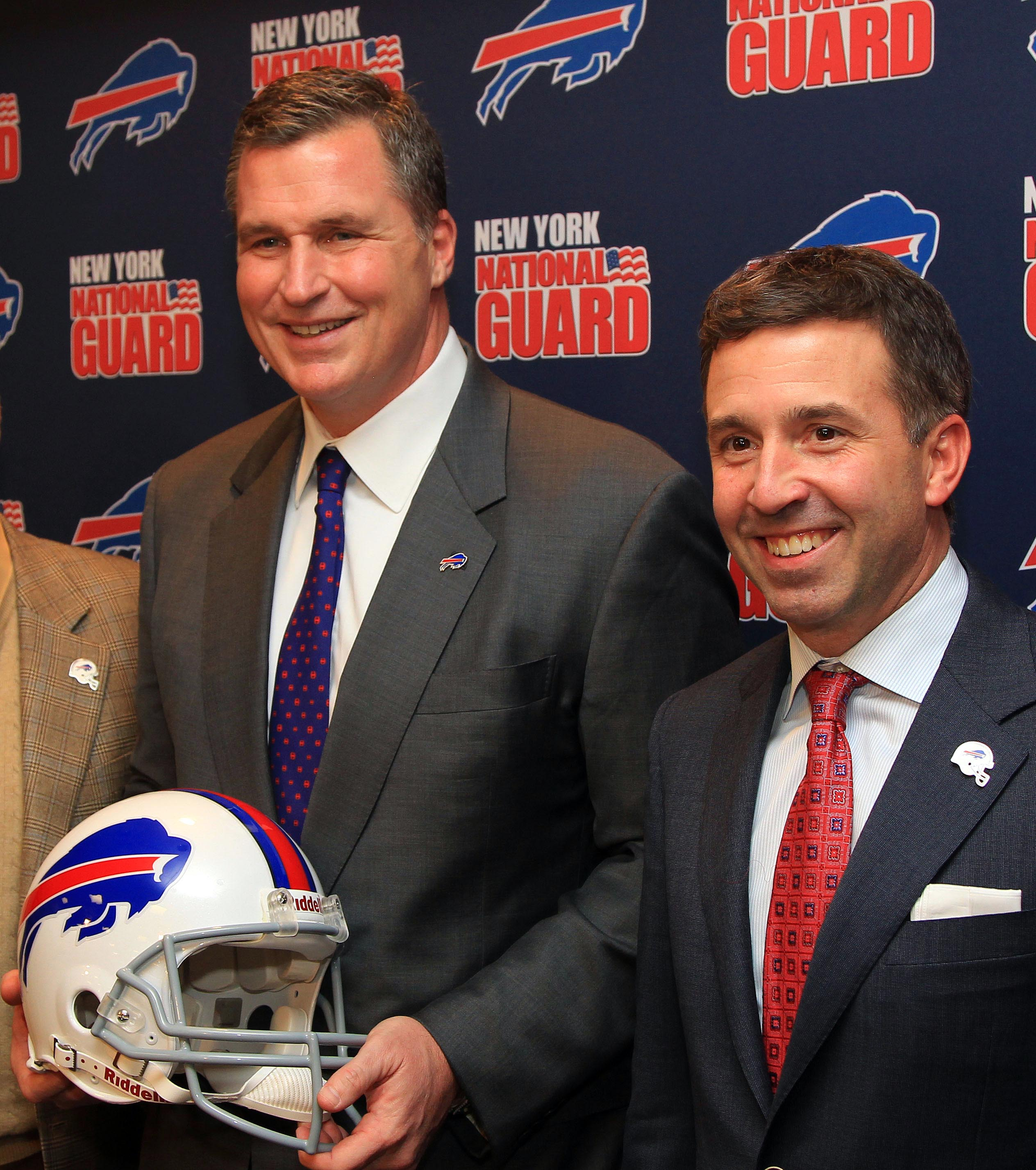 Bills president Russ Brandon, right, is a big believer in Marrone. (USA Today Sports)