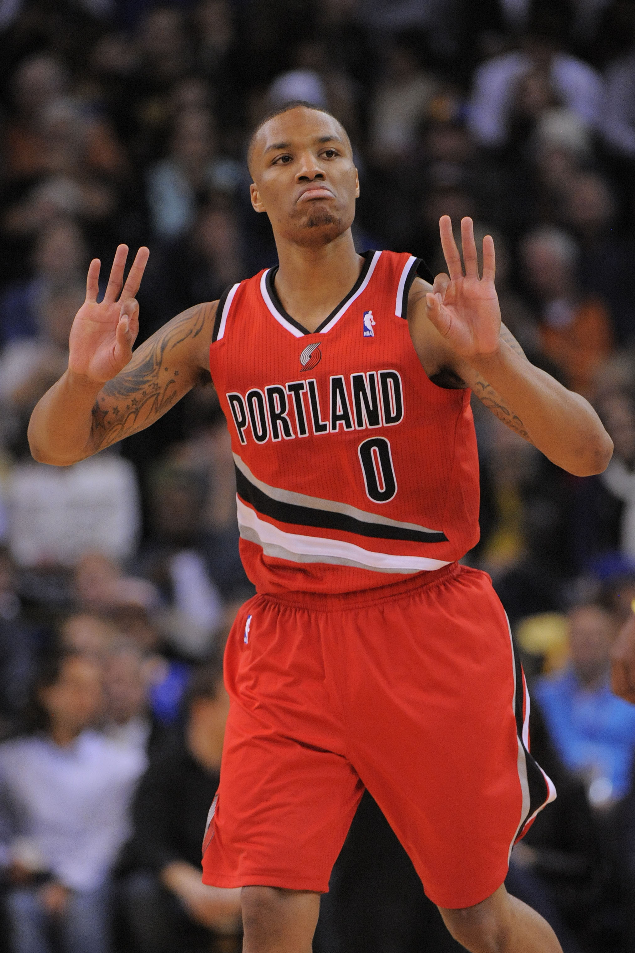 Damian Lillard is averaging 18.5 points and 6.5 assists this season. (USA Today Sports)