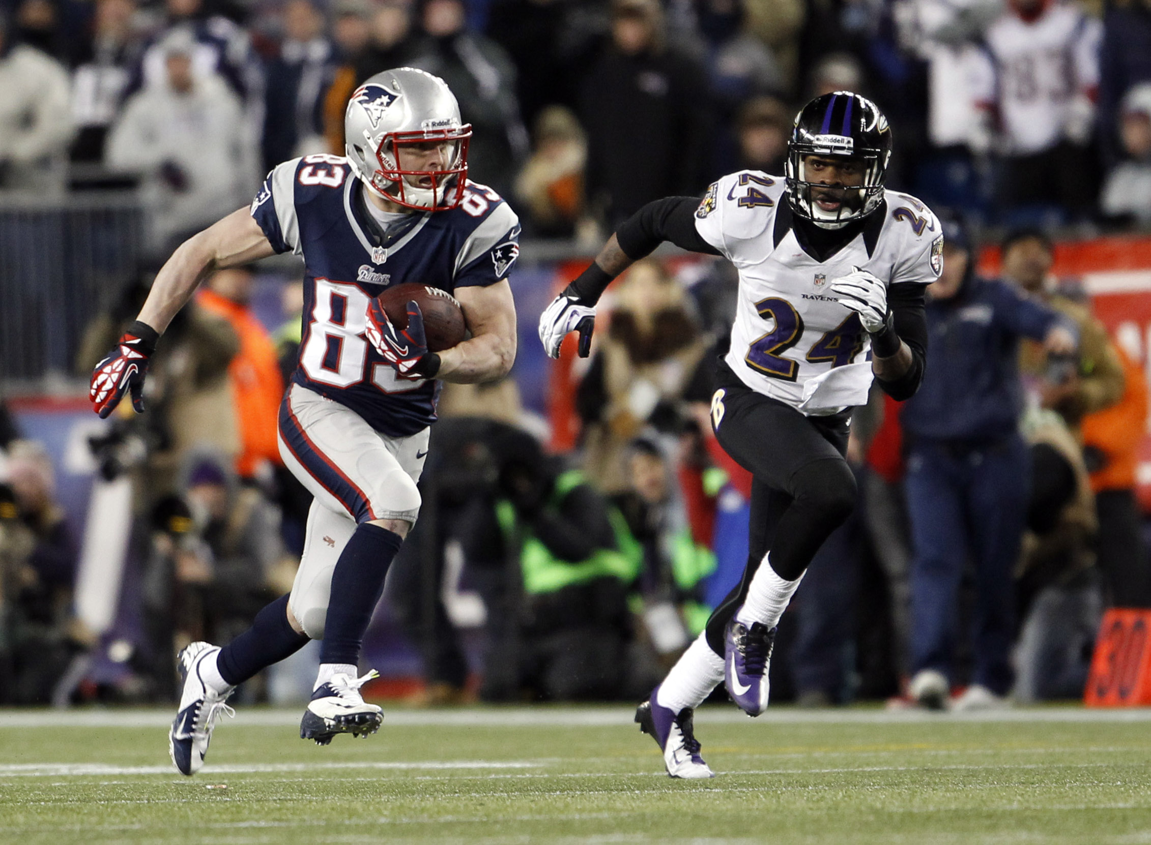 Wes Welker runs past Ravens CB Corey Graham in the AFC title game. (USA TODAY Sports)