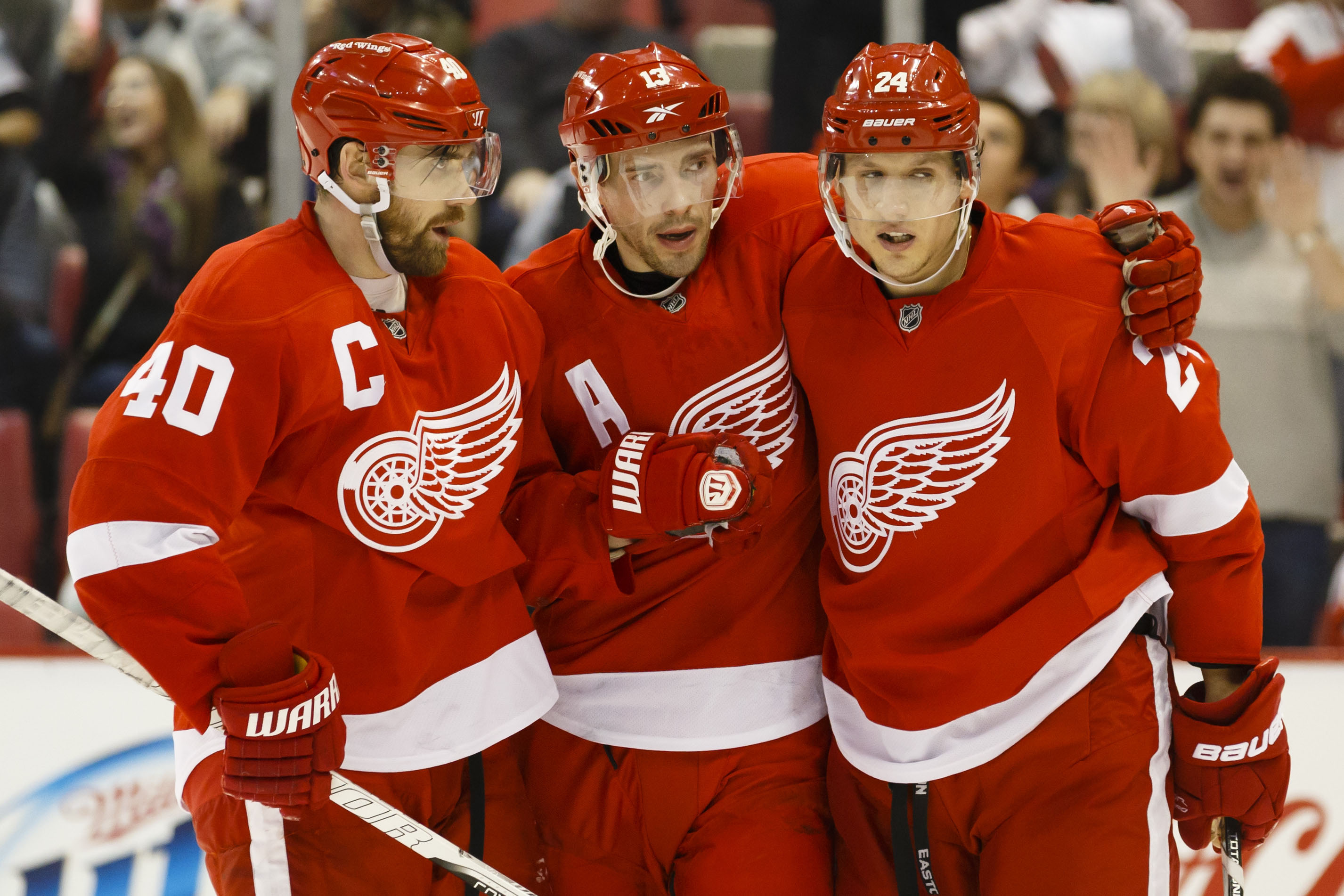 Henrik Zetterberg and Pavel Datsyuk welcome Damien Brunner (L-R) to Detroit. (USA Today)