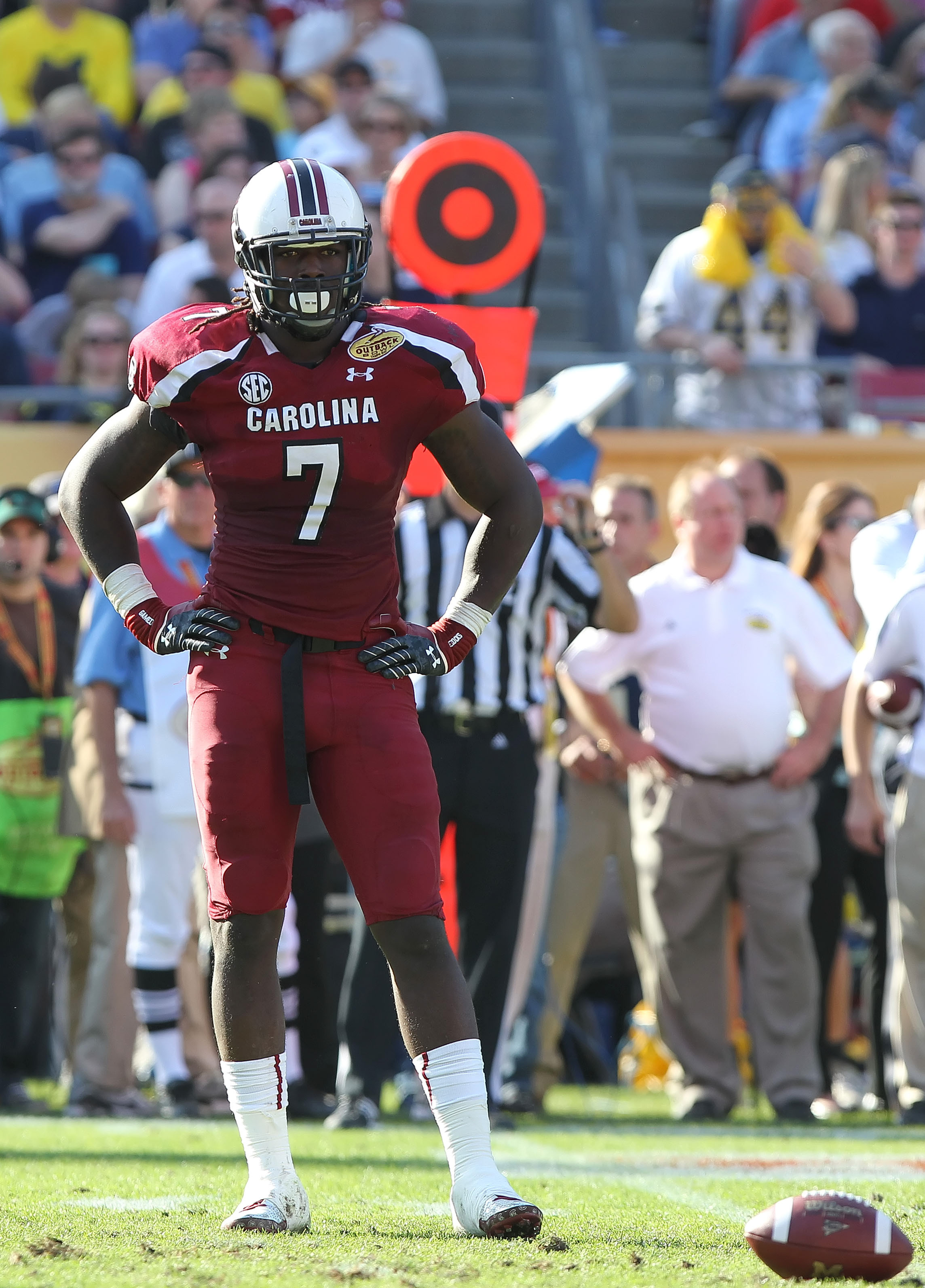 Jadeveon Clowney and other college players now risk ejection for helmet-to-helmet hits. (USA Today Sports)
