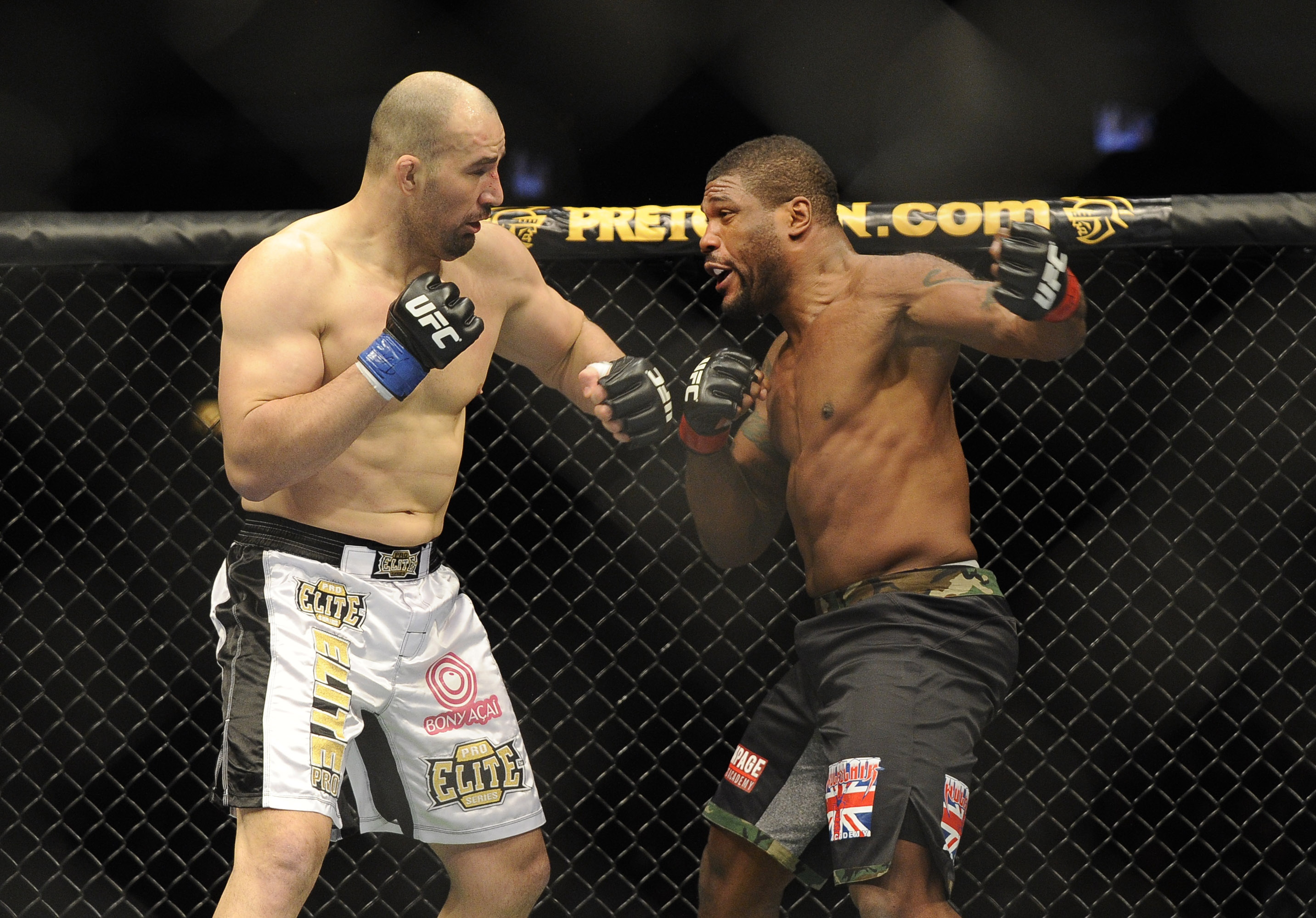 Rampage Jackson swings at Glover Teixeira during their fight. (USA Today Sports)