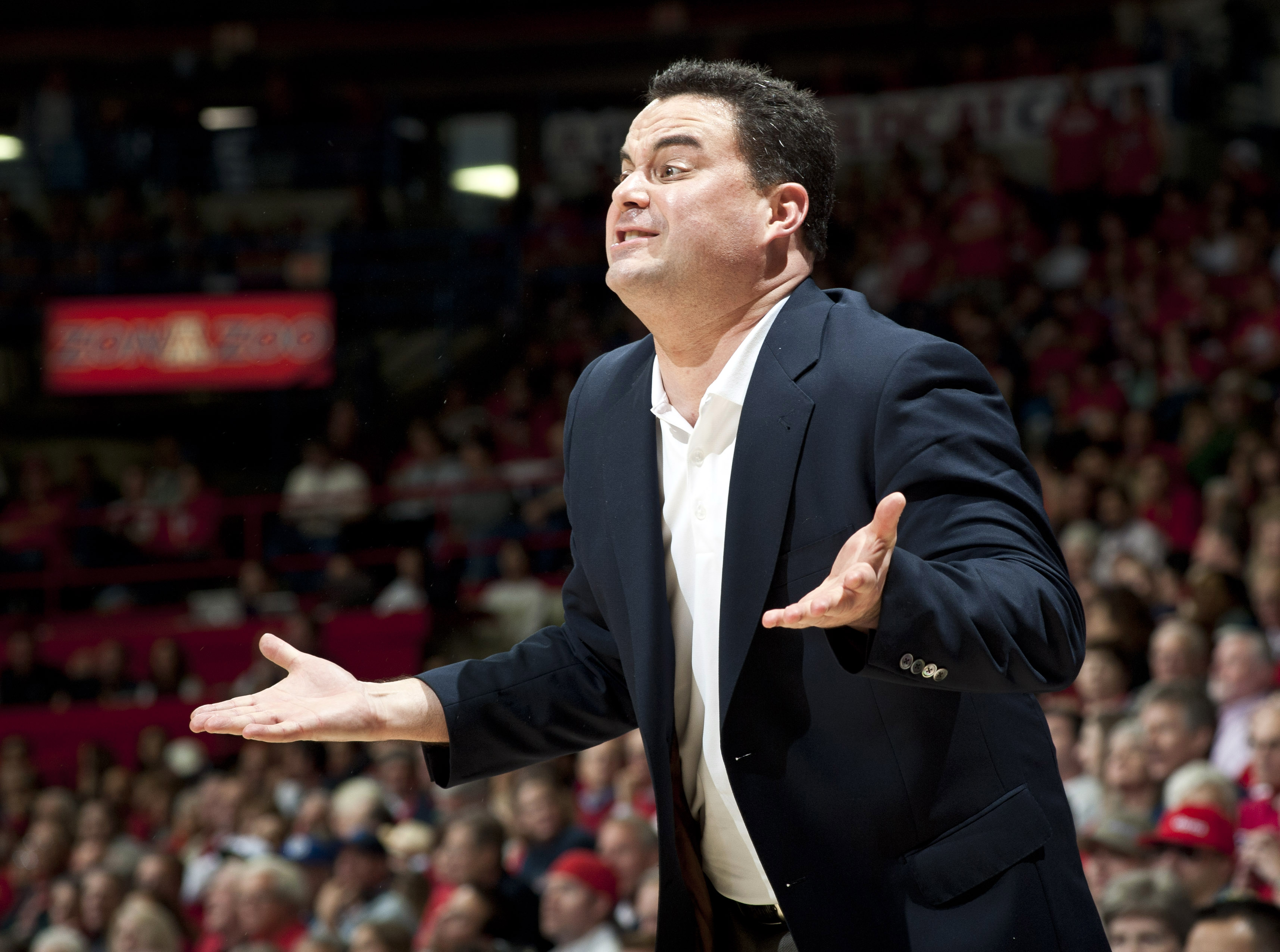 As a young player, Arizona coach Sean Miller's father was his toughest critic . (USA TODAY)