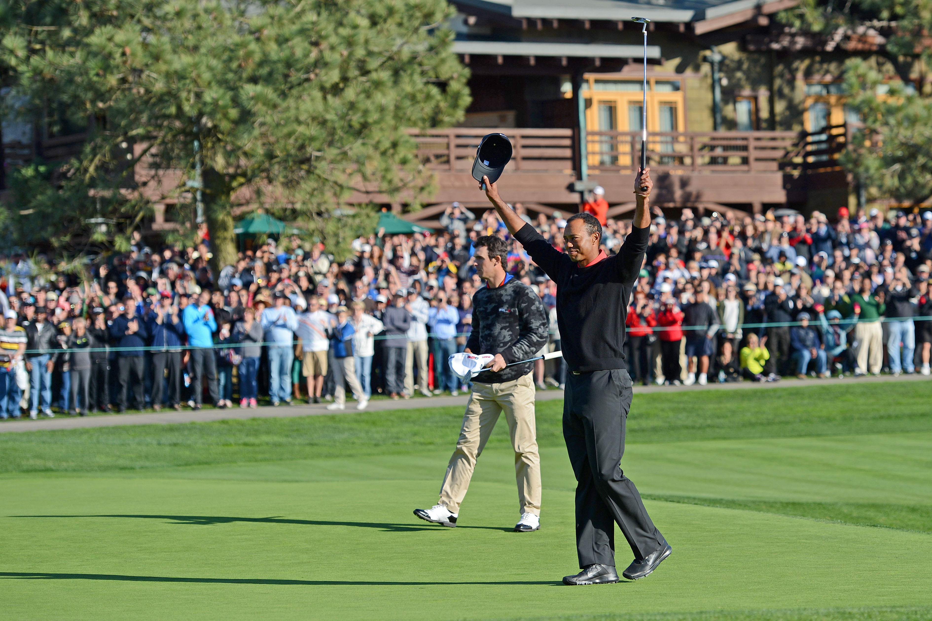 Tiger Woods celebrates after winning the Farmers Insurance Open. (USA Today Sports)