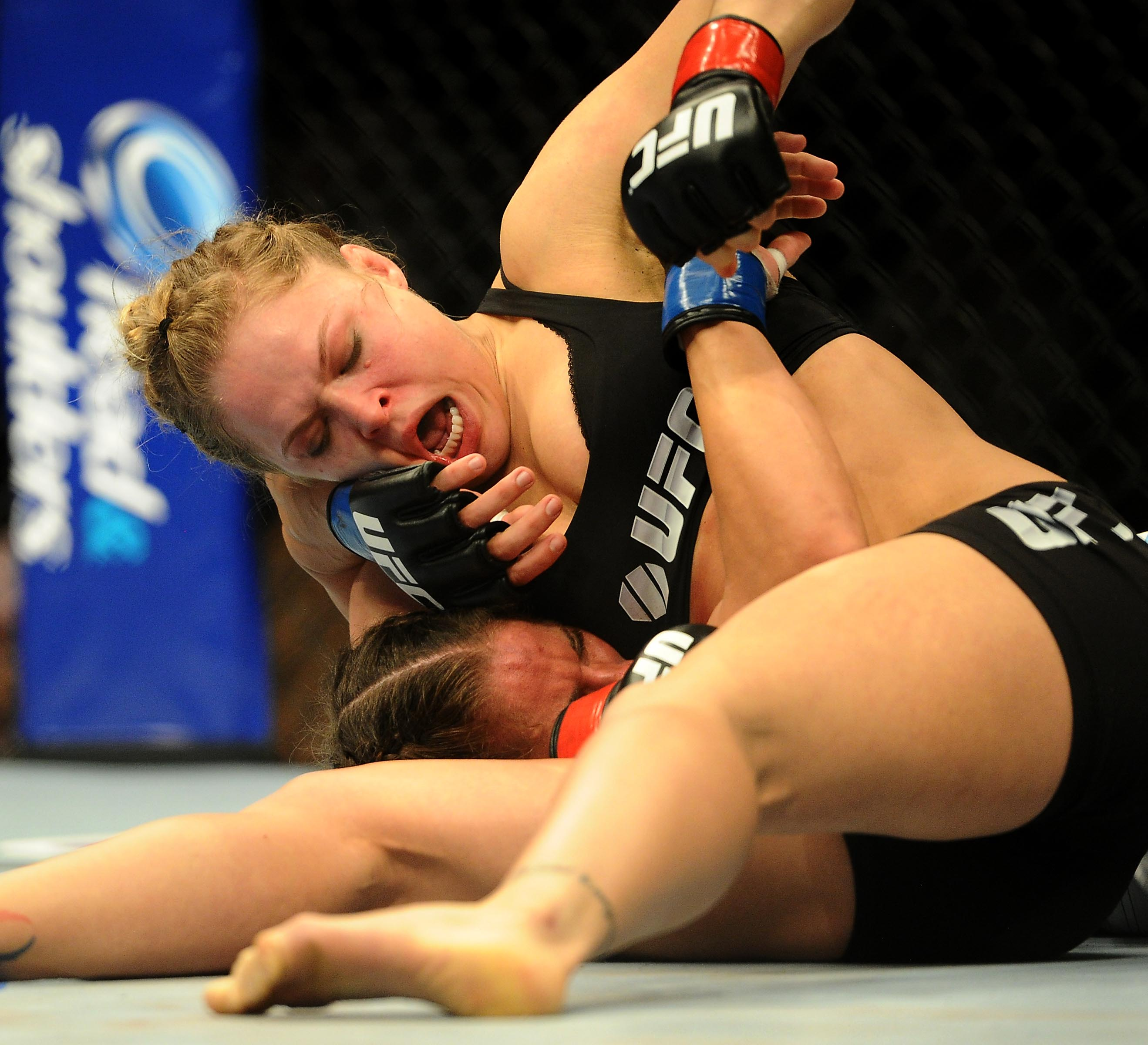 Ronda Rousey and Liz Carmouche jostle for position Saturday. (USA Today Sports)