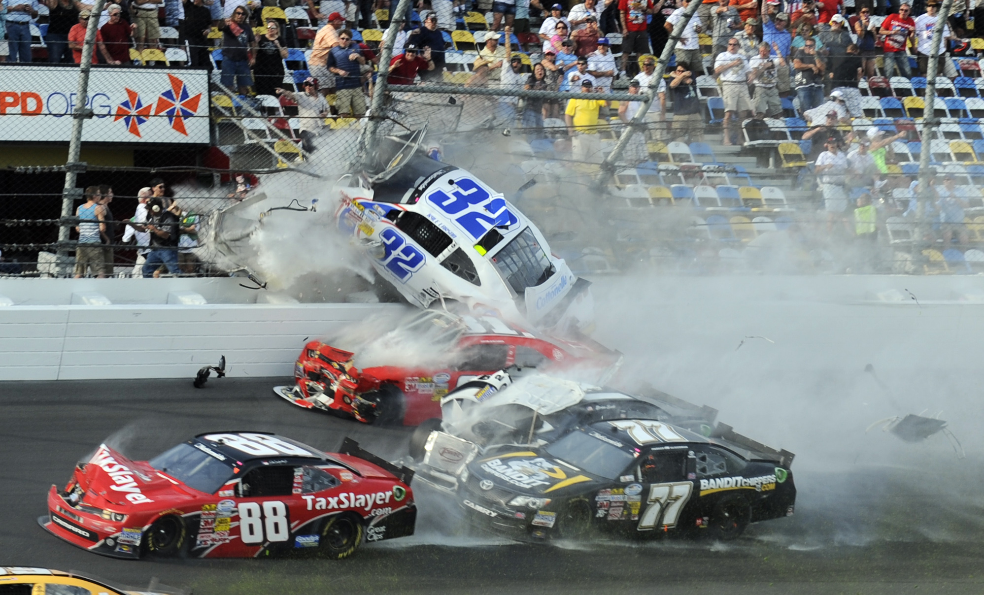 Kyle Larson goes up into the fence near Section I at Daytona International Speedway. (USA Today Sports)