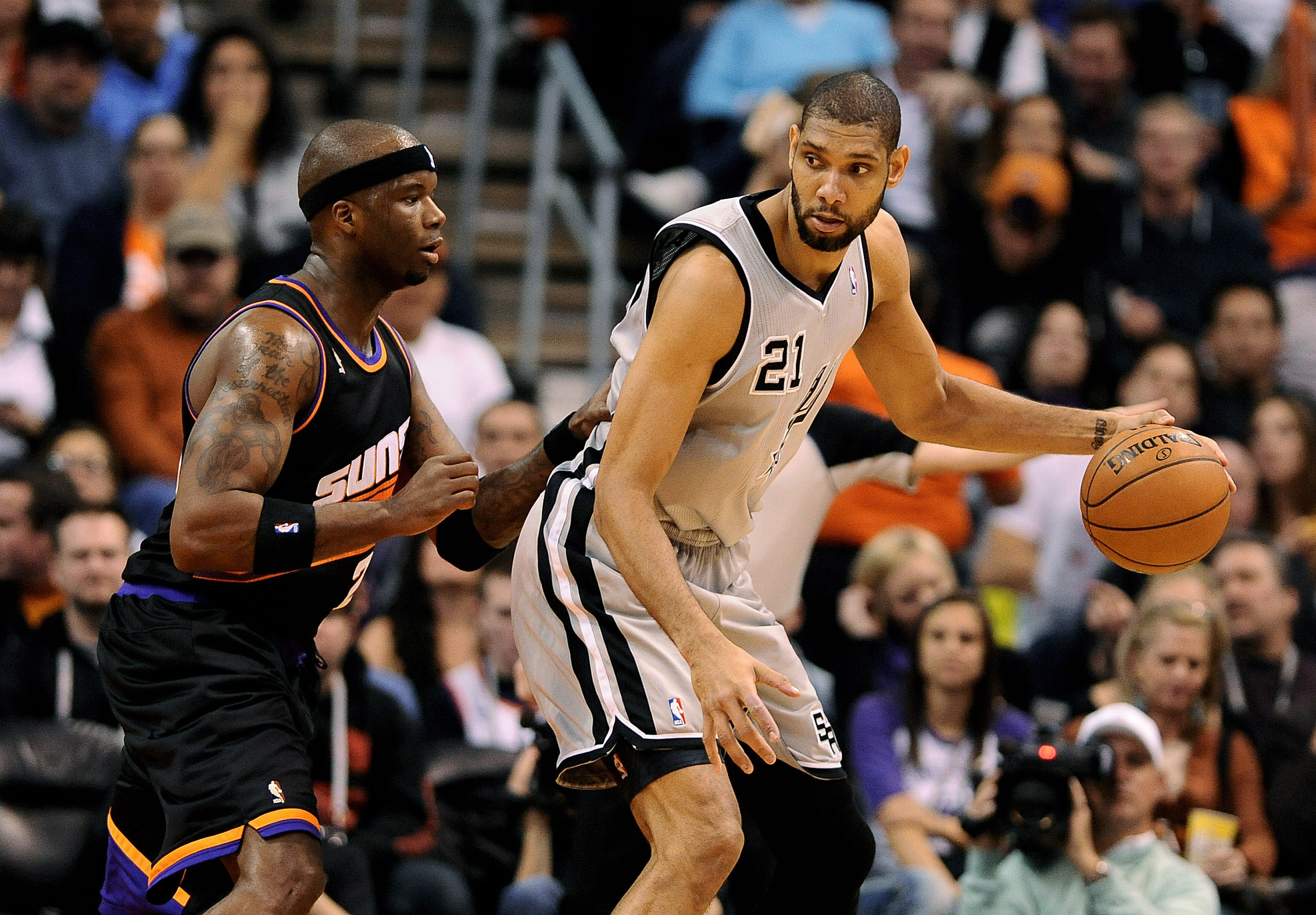 Tim Duncan, working against the Suns' Jermaine O'Neal, has helped keep the Spurs on top. (USA Today Sports)