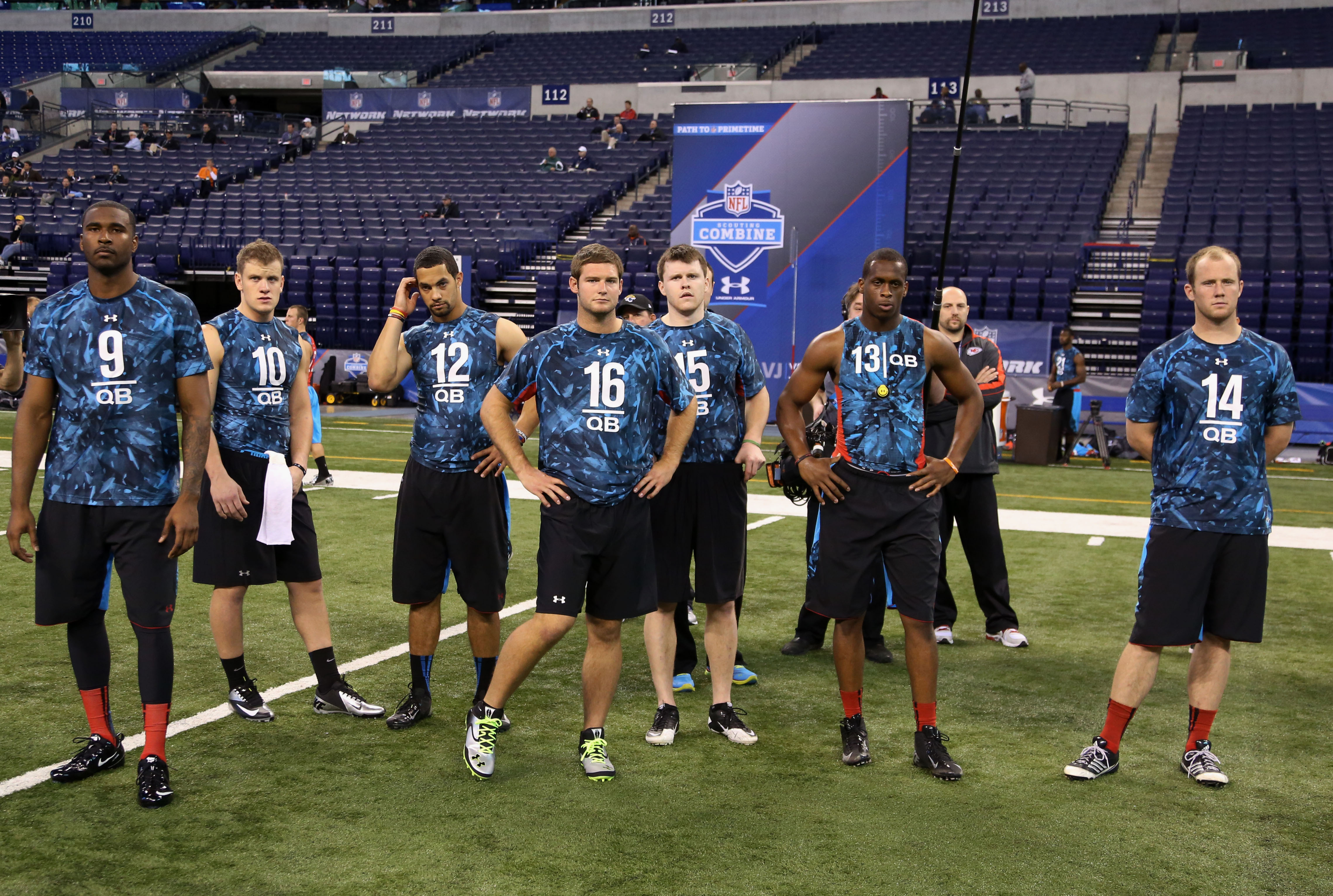 A bunch of QBs convene before drills at this year's NFL scouting combine at Lucas Oil Stadium. (USA TODAY Sports)