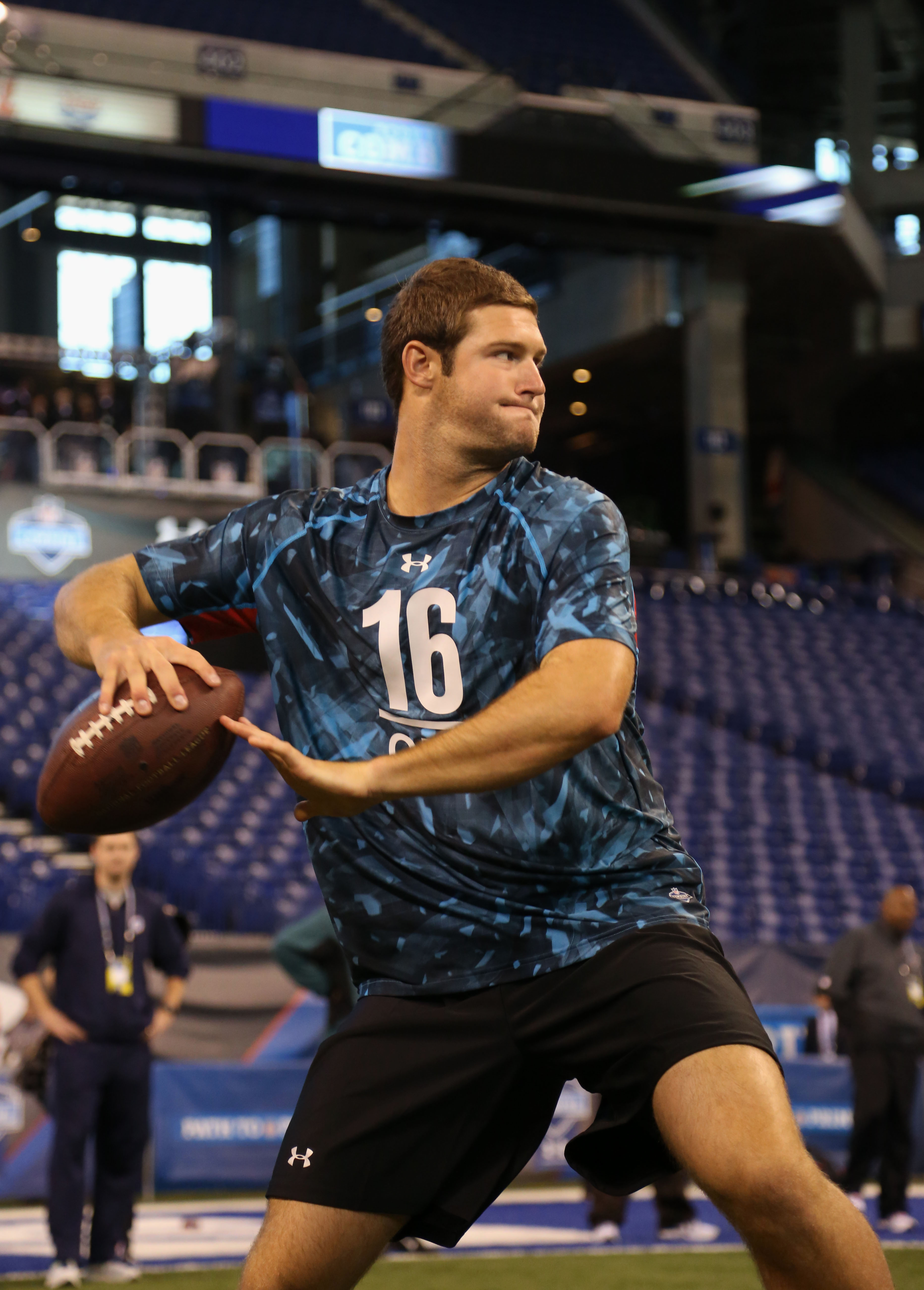 Tyler Wilson participates in a passing drill during last month's NFL scouting combine. (USA TODAY Sports)