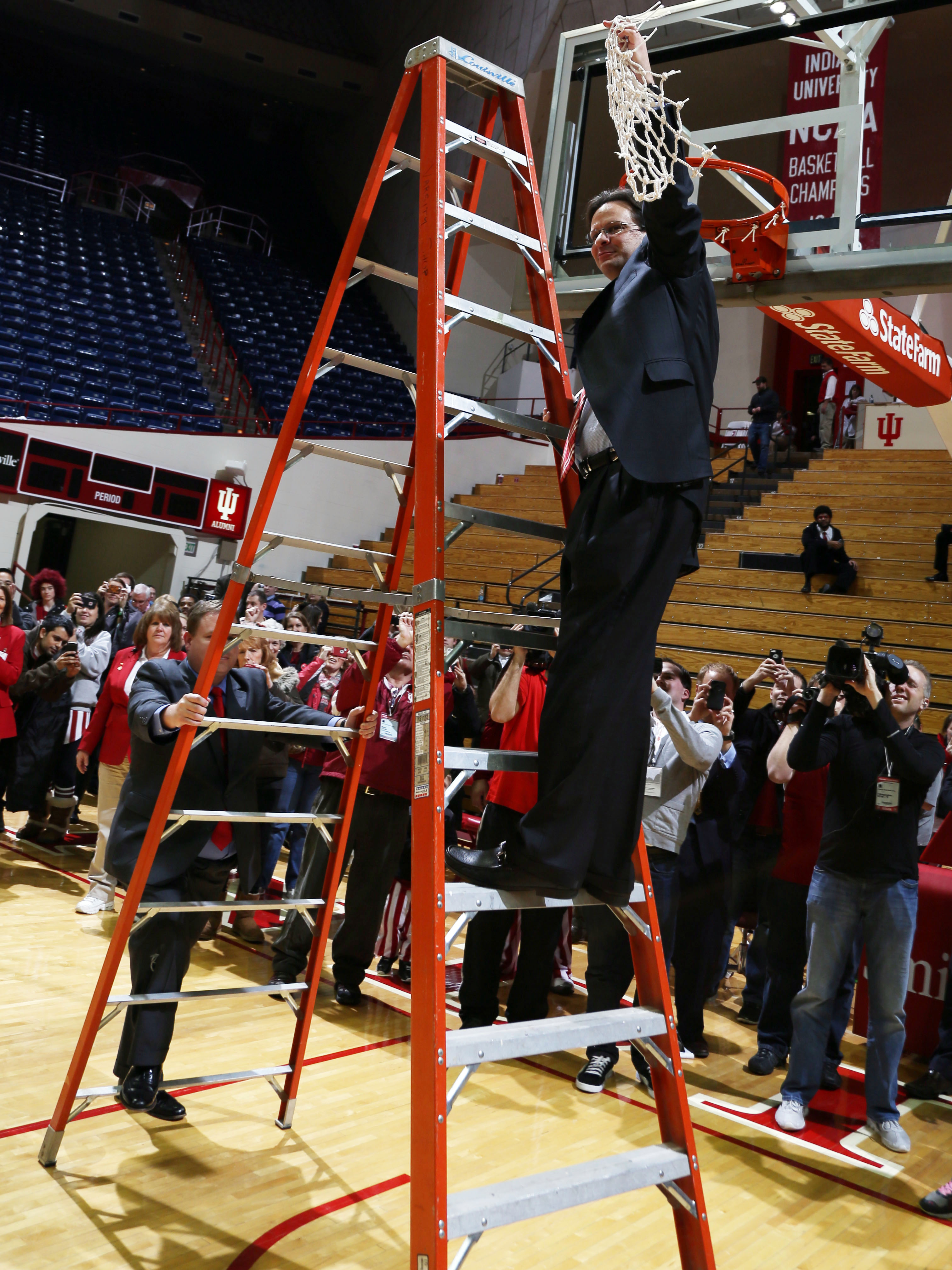 Tom Crean cuts down the net after Indiana clinched a share of the Big Ten title. (Credit: USA Today Sports)