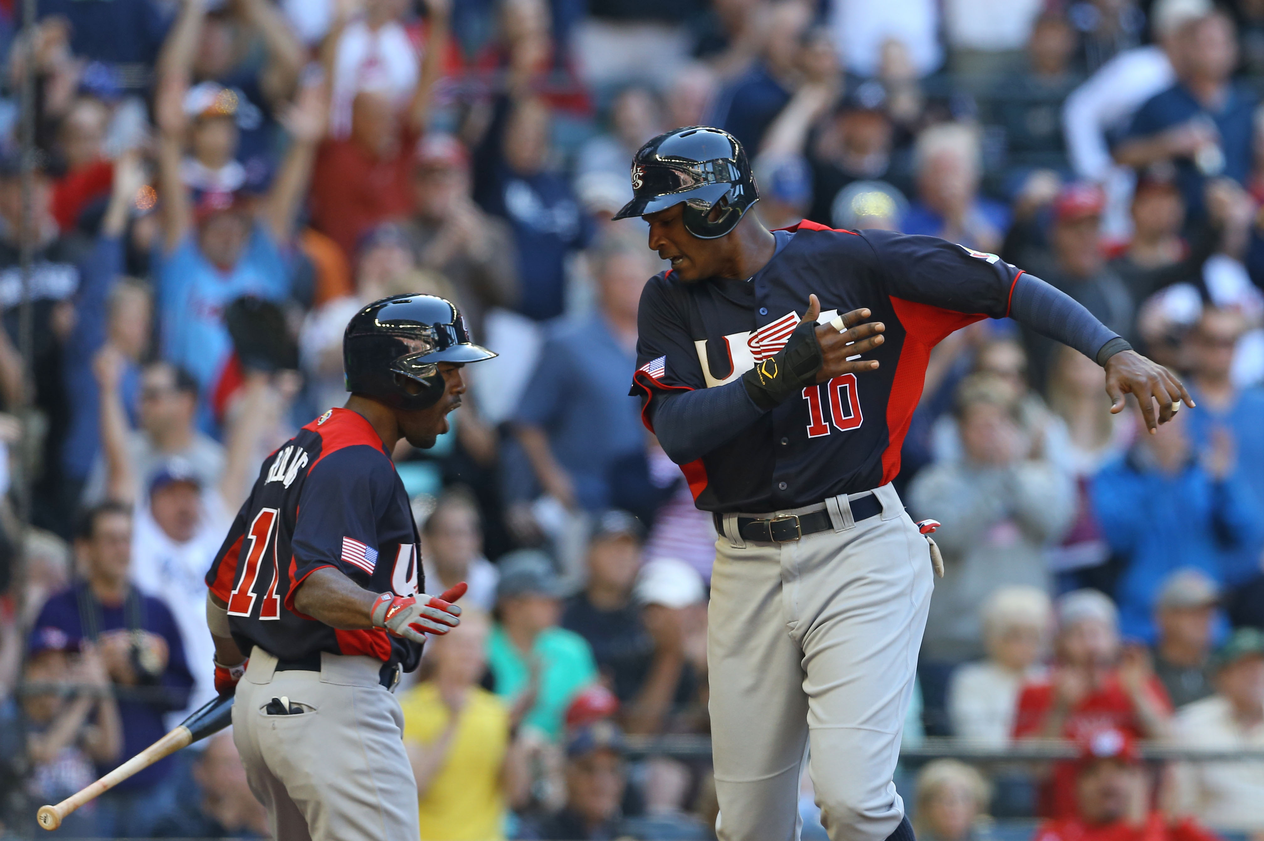 Before scoring in the eighth inning, Adam Jones (R) had the biggest hit for Team USA. (USA Today Sports)