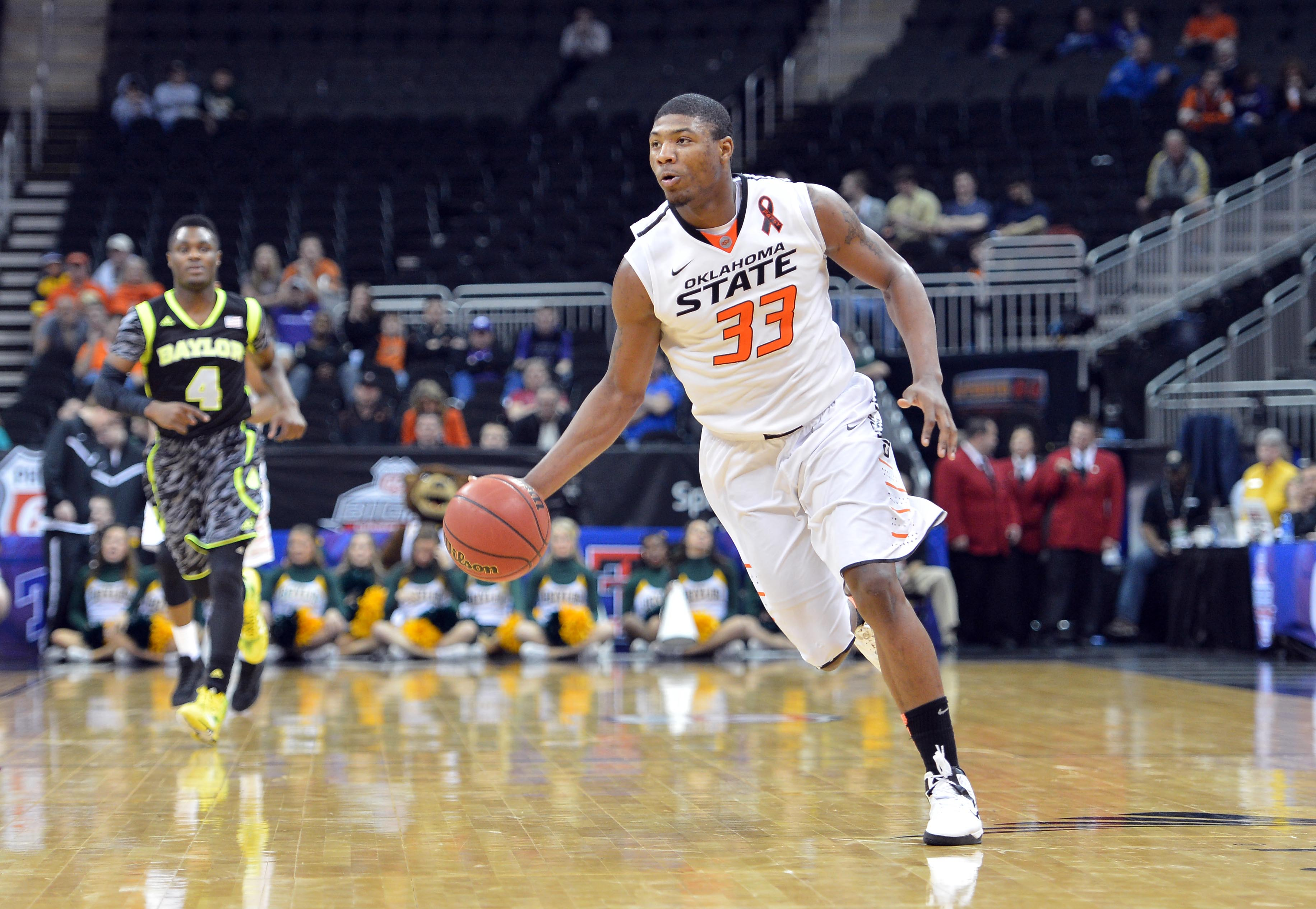 Marcus Smart averaged 15.4 points and 5.8 rebounds last season. (USA Today Sports)