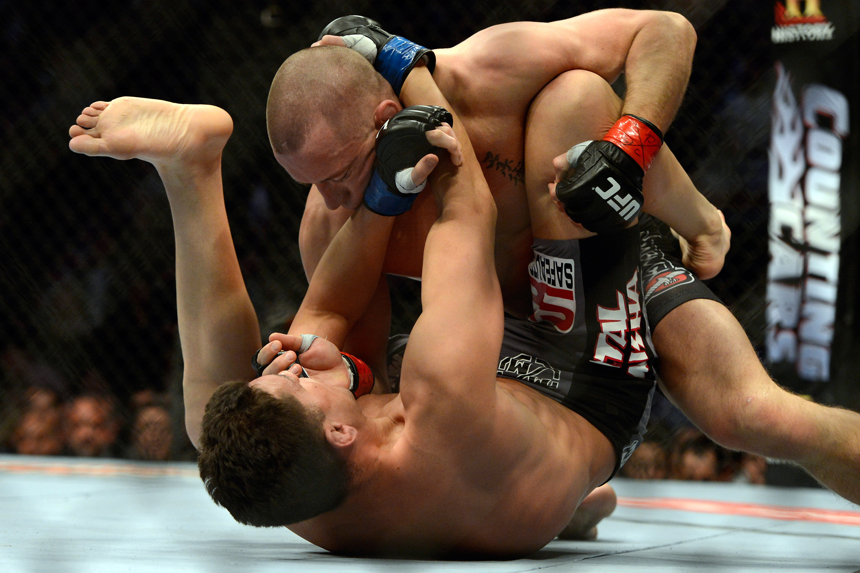 Georges St-Pierre throws punches at Nick Diaz during their welterweight fight. (USA Today Sports)