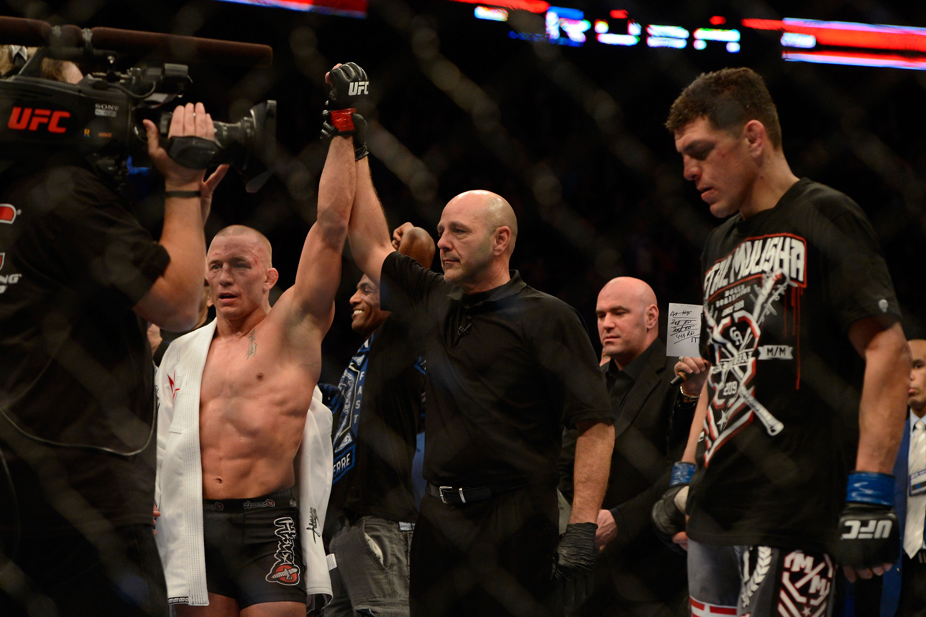 Georges St.Pierre's hand is raised after a win over Nick Diaz. (USA Today Sports)
