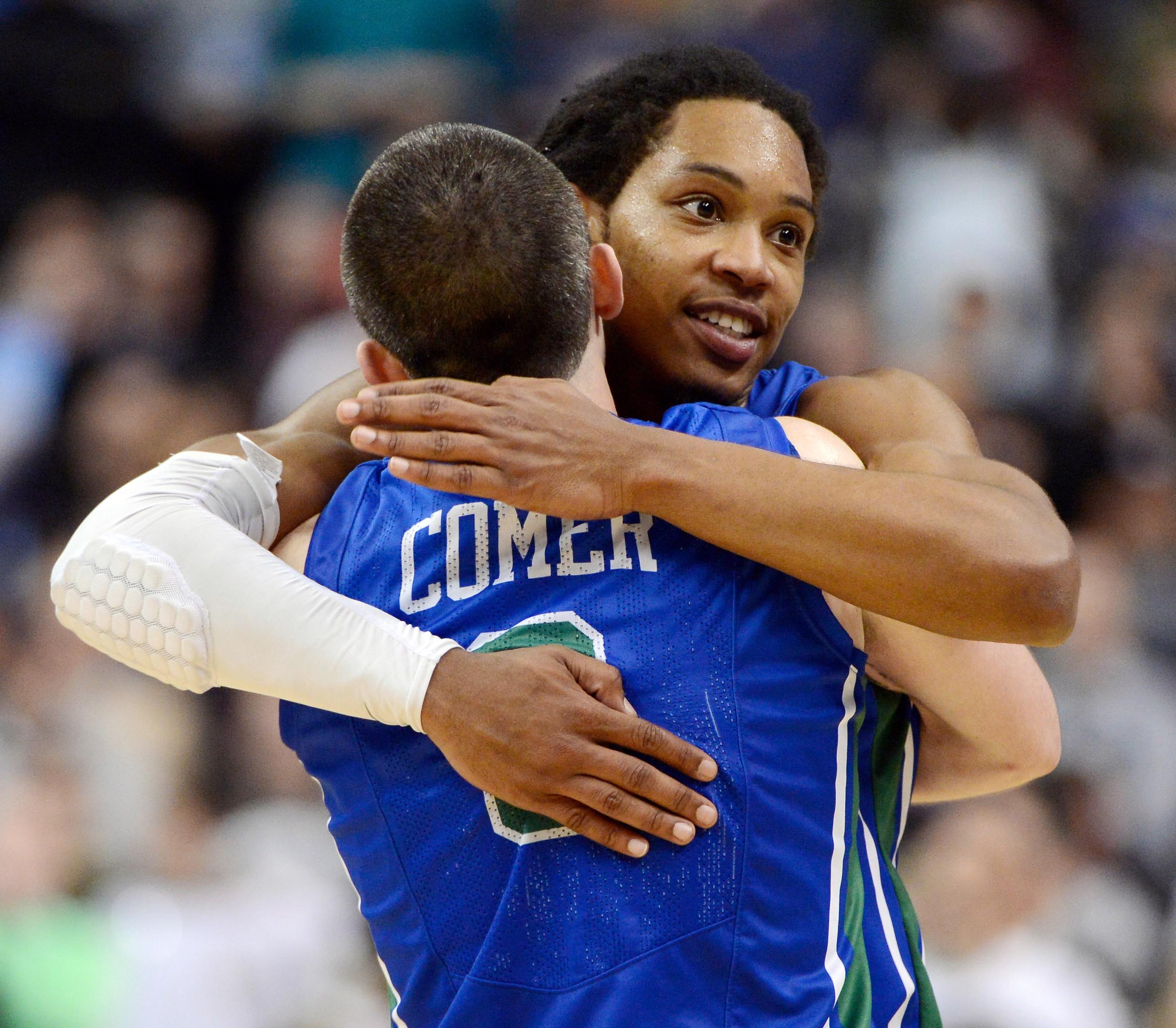 Brett Comer gets a hug from Sherwood Brown to celebrate Florida Gulf Coast's stunner over Georgetown. (USA TODAY Sports)