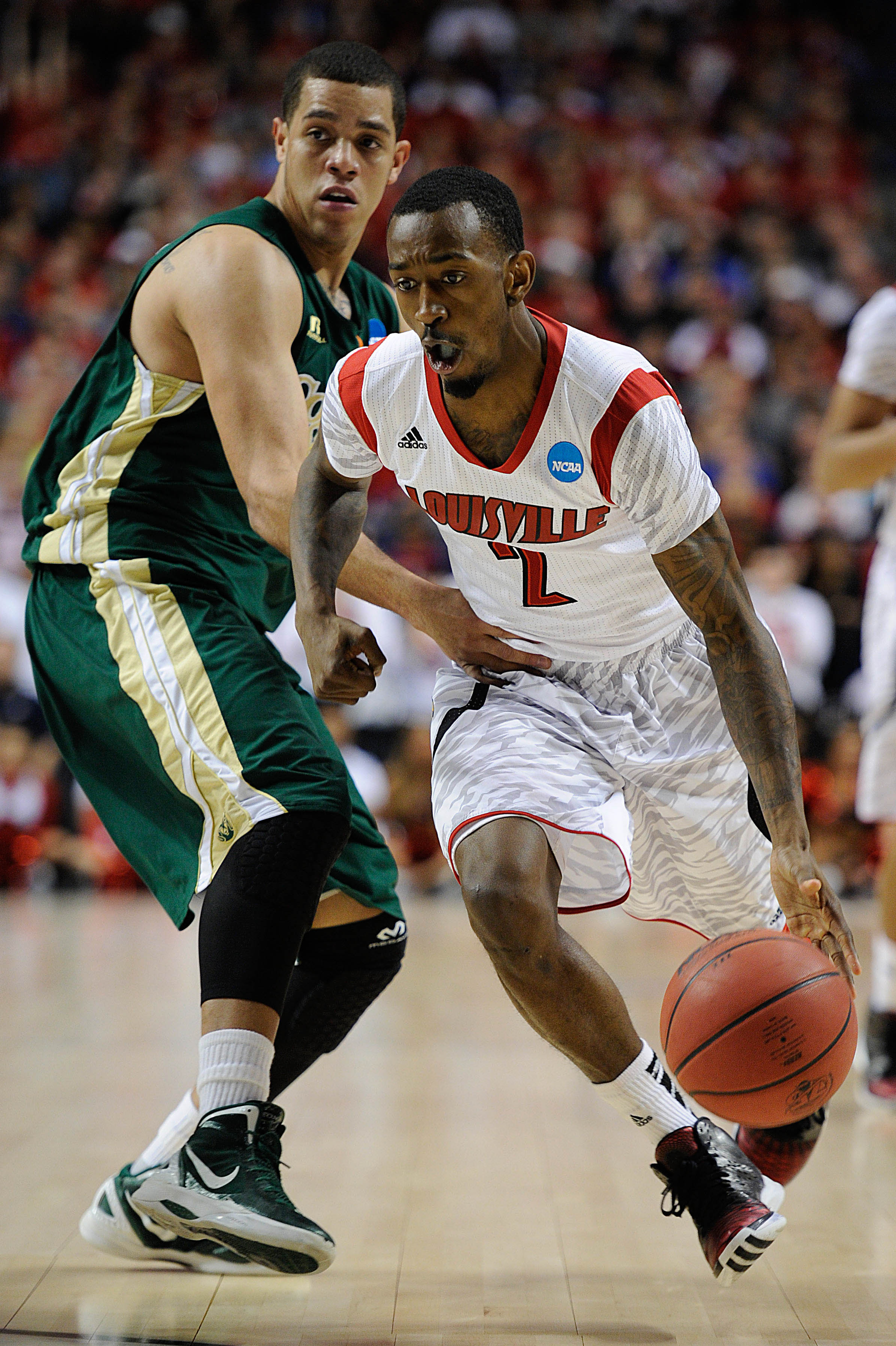 Russ Smith averaged 18.7 points for the Cardinals last season. (USA Today Sports)