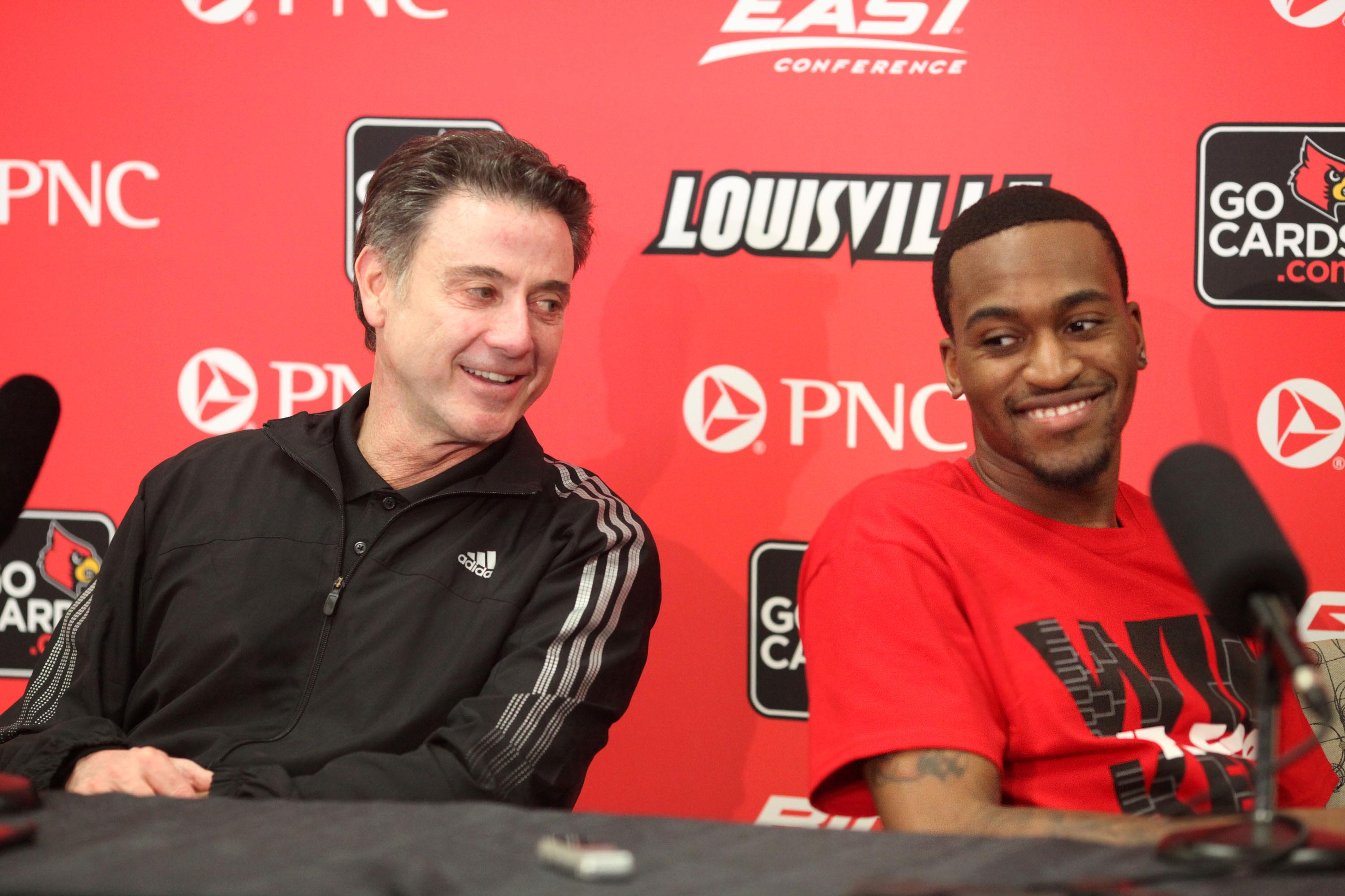 Louisville coach Rick Pitino and Kevin Ware laugh during a press conference Wednesday. (USA Today)