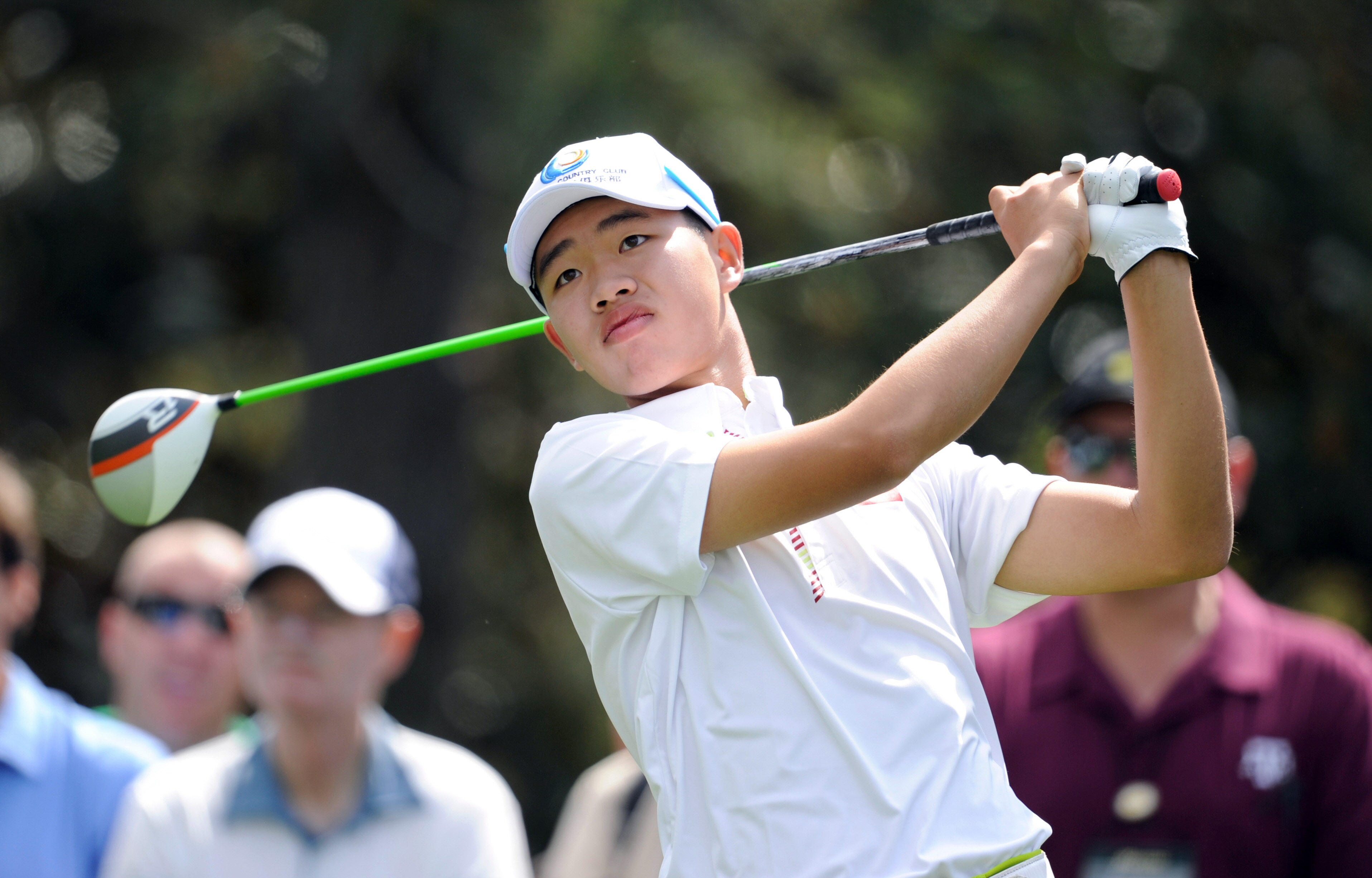 Tianlang Guan hits from the 15th tee during practice round play at Augusta National. (USAT Sports)