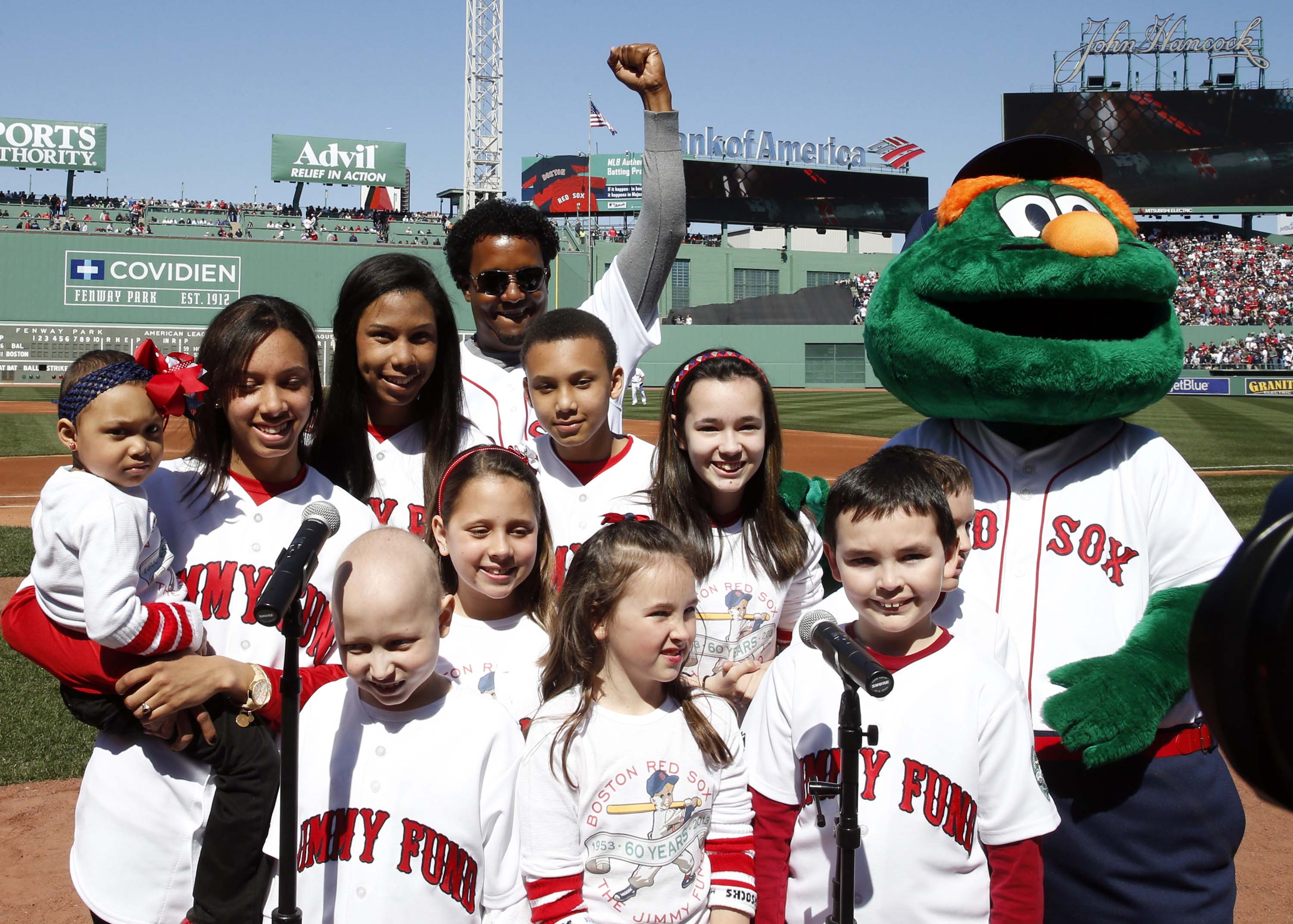 Former Red Sox pitcher Pedro Martinez takes pictures with fans before the start of opening day in April. (USAT)