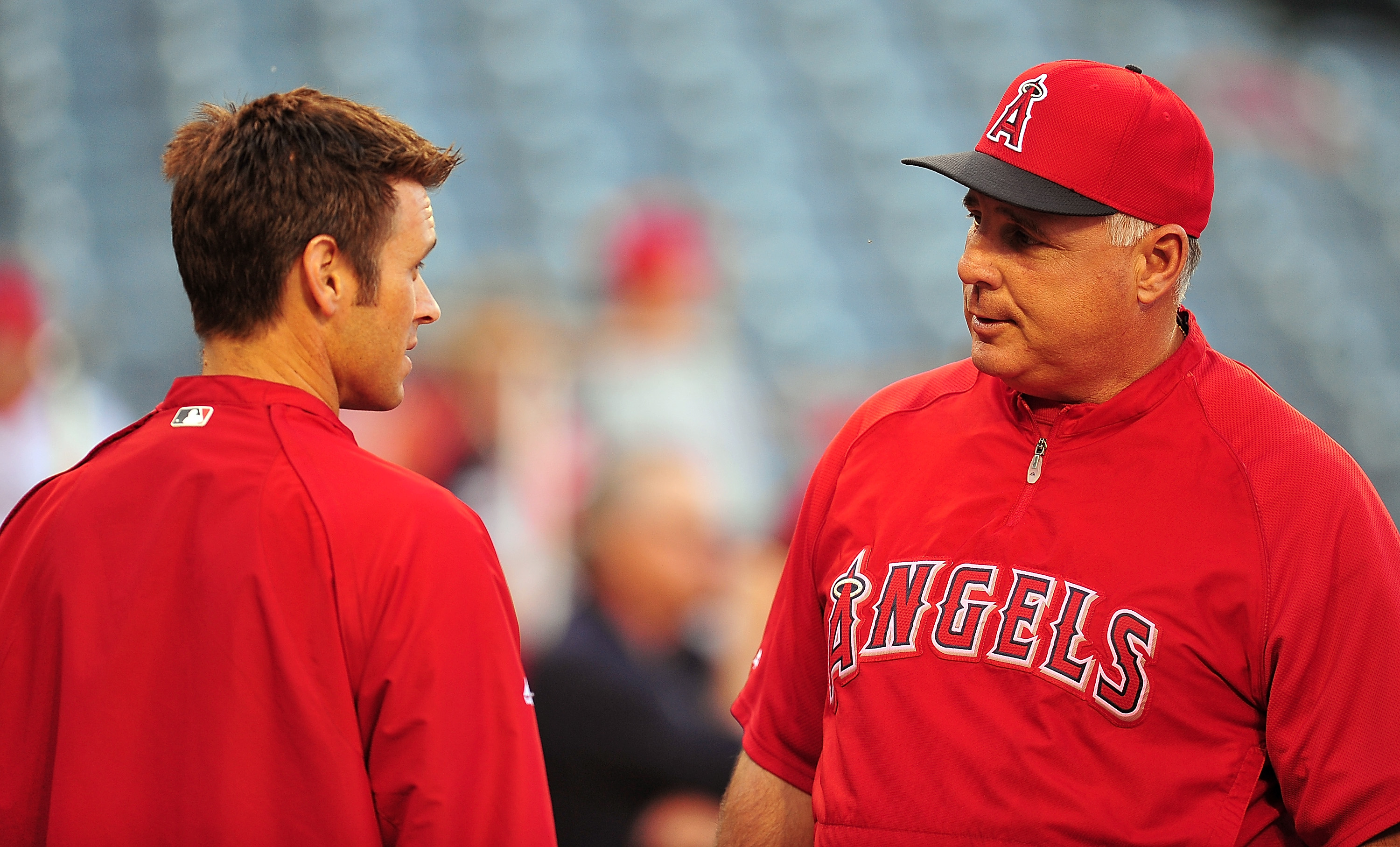 Angels GM Jerry Dipoto, left, and manager Mike Scioscia haven't been on the best of terms. (USA Today Sports)