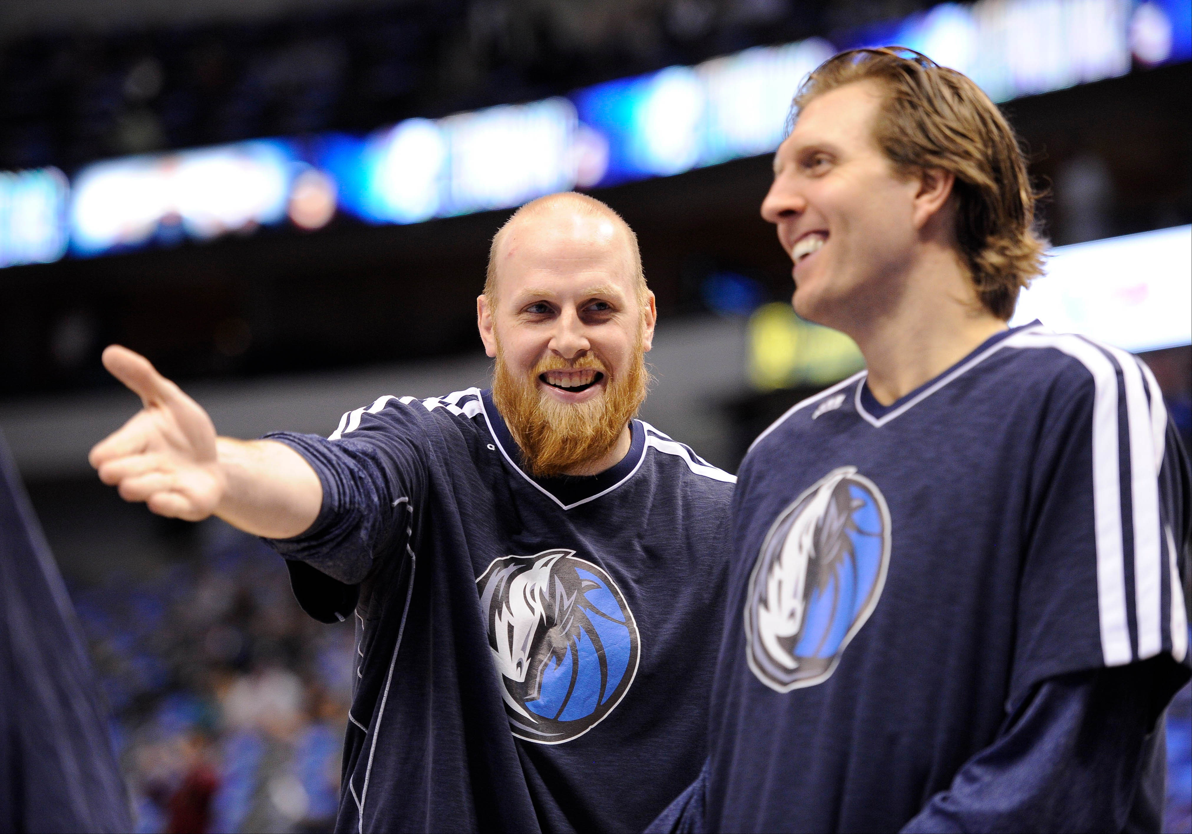 Chris Kaman (L) is shown with Dirk Nowitzki. (USA Today)