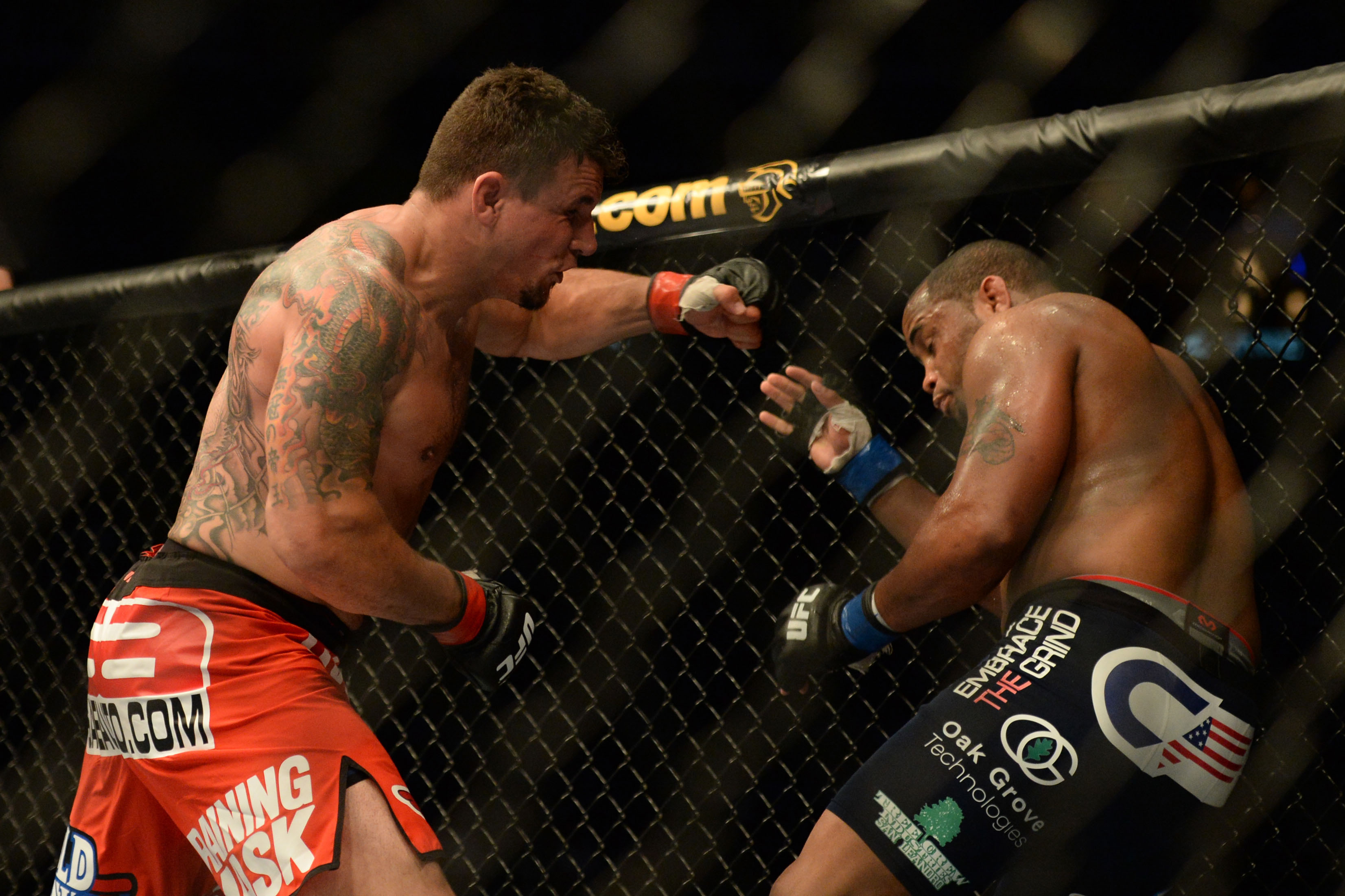 Frank Mir punches Daniel Cormier during their heavyweight fight. (USA Today)