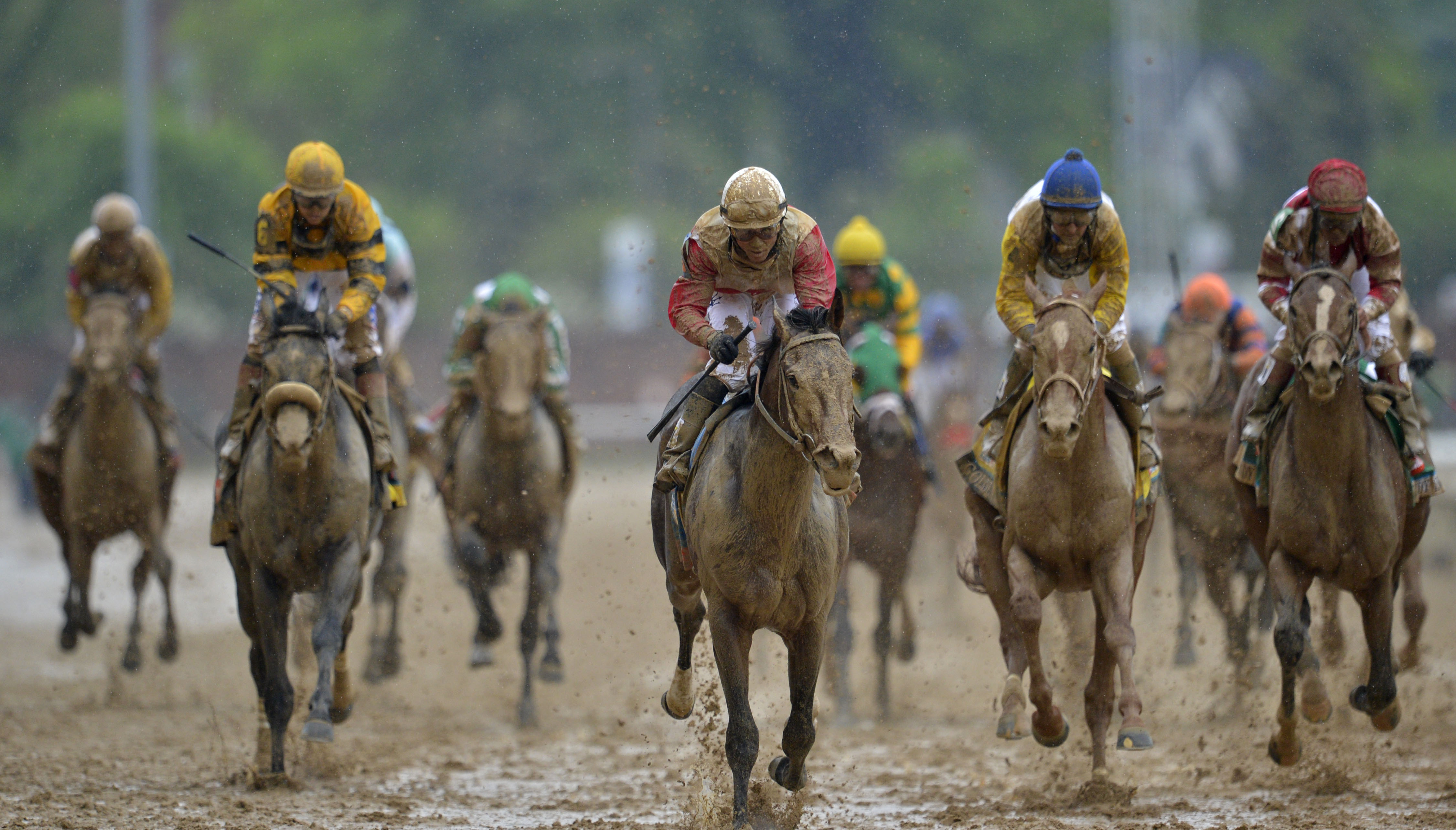 Joel Rosario aboard Orb (middle) leads the field down the final stretch at Churchill Downs. (USA Today)