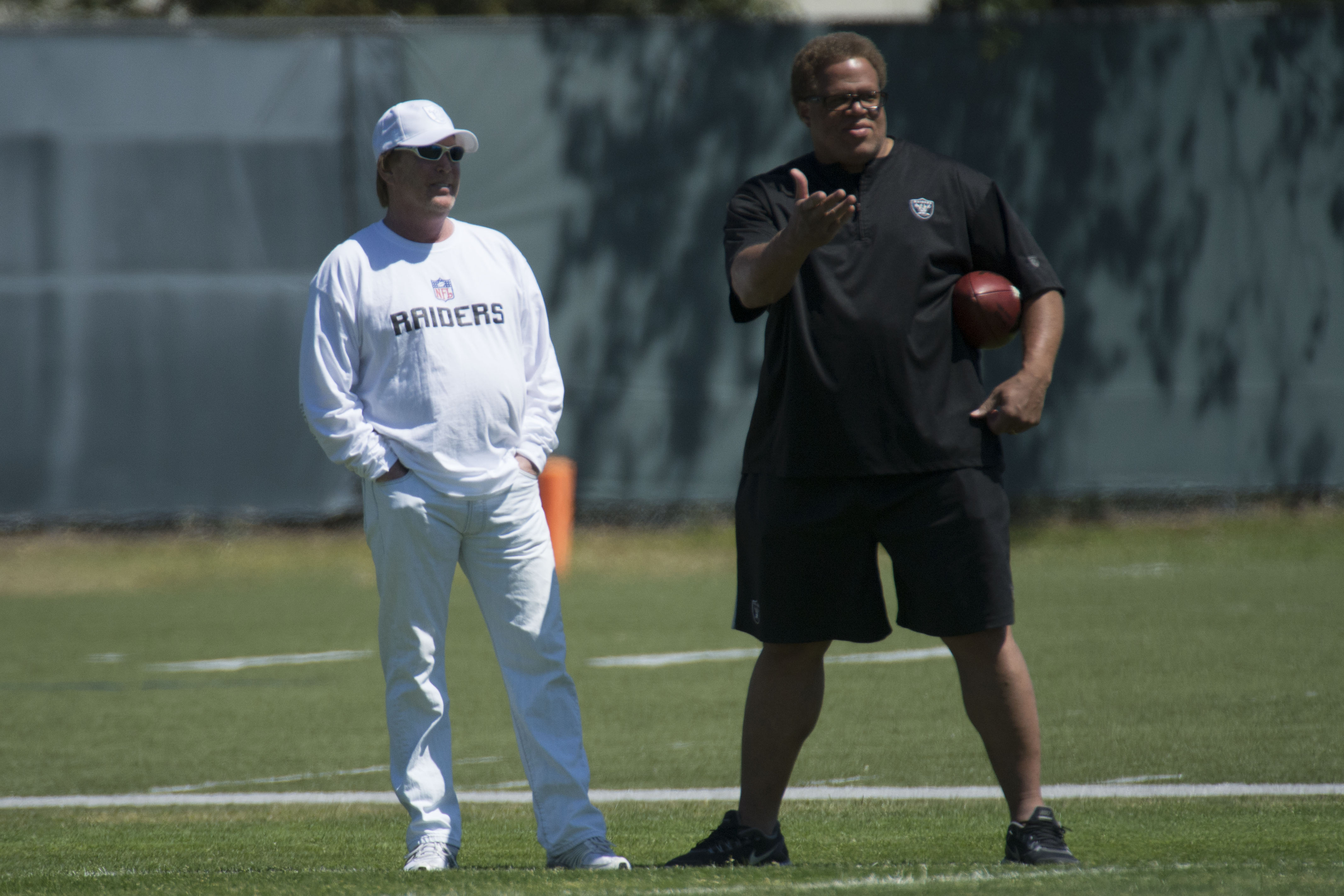 Raiders owner Mark Davis (L) talks to GM Reggie McKenzie (R) during rookie minicamp. (USA Today)