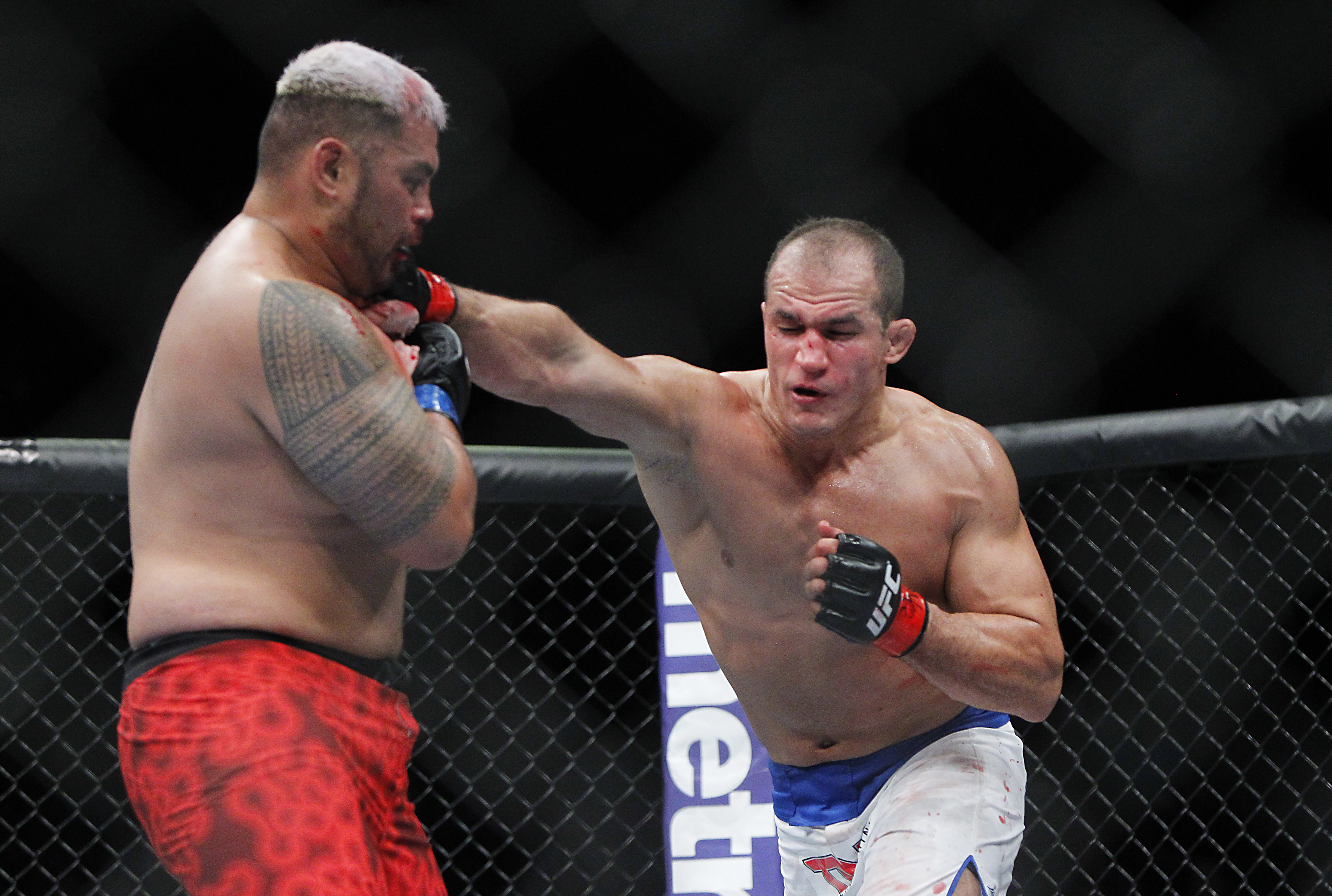 Junior dos Santos fancies himself a boxer. Would you disagree? (USA Today)