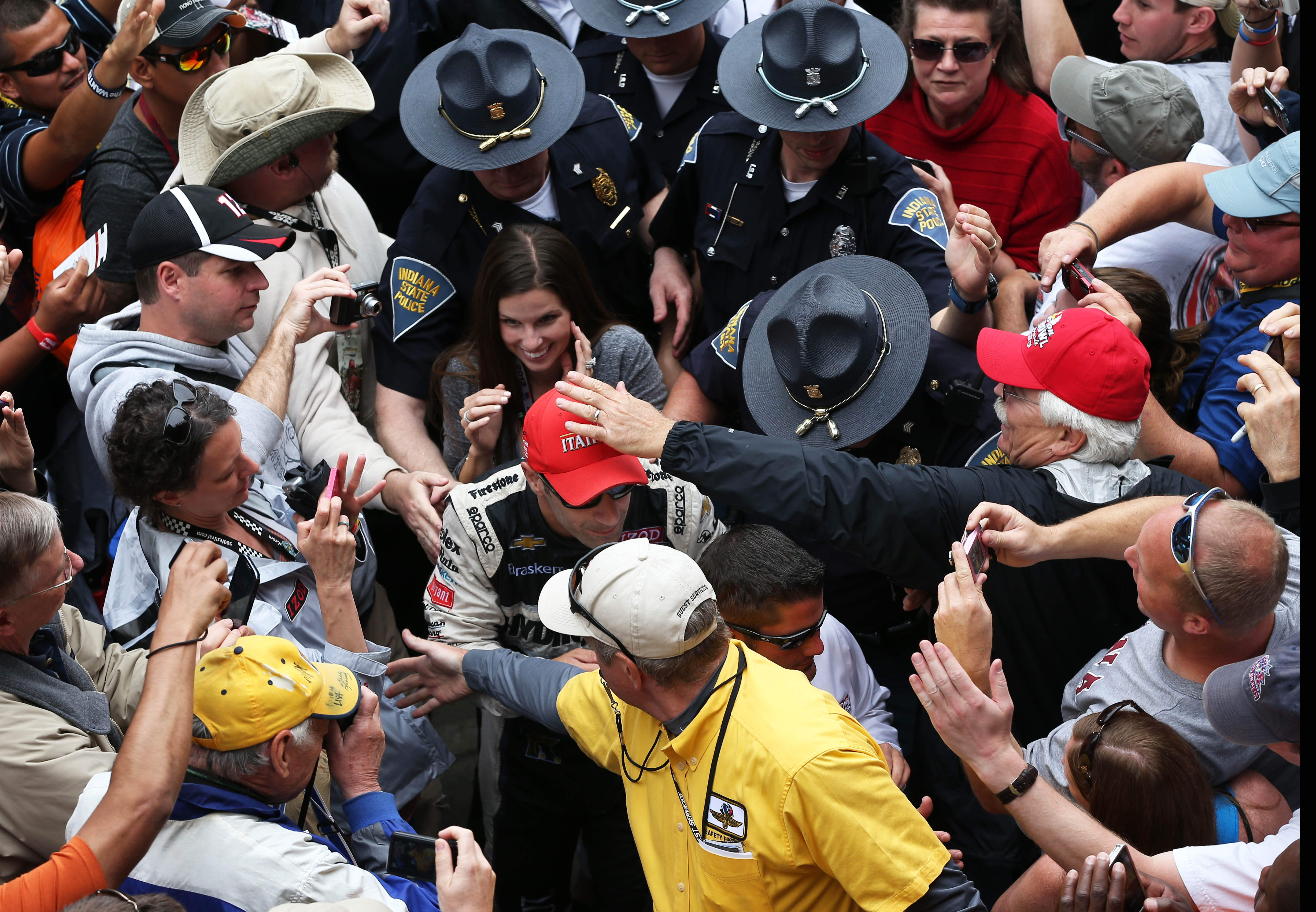 Fans at IMS congratulate Tony Kanaan on his first Indianapolis 500 victory. (USAT Sports)